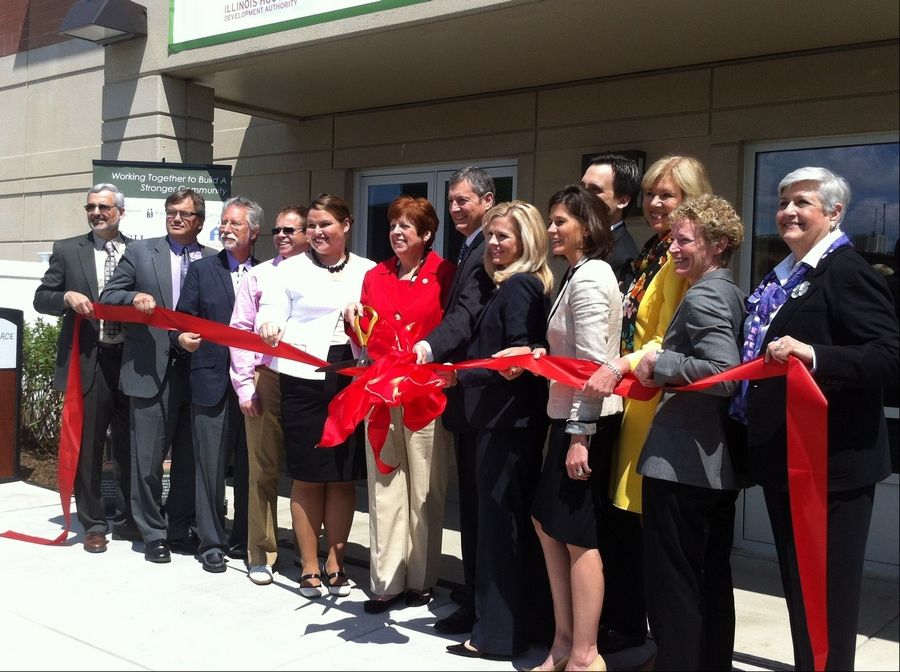Developers and community leaders cut the ribbon in front of Myers Place in Mount Prospect on Monday.