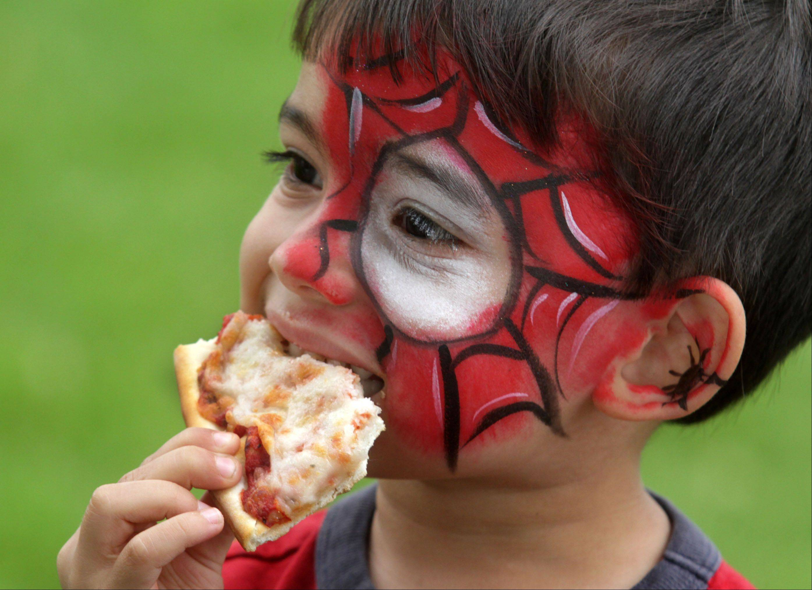 Myles Patten-Muzones has an eye for pizza pie after having his face painted at Art in the Park at Lehmann Park in Lake Villa on Saturday. Myles was at the event with his mom Michele Van Patten-Muzones, who was showing art.