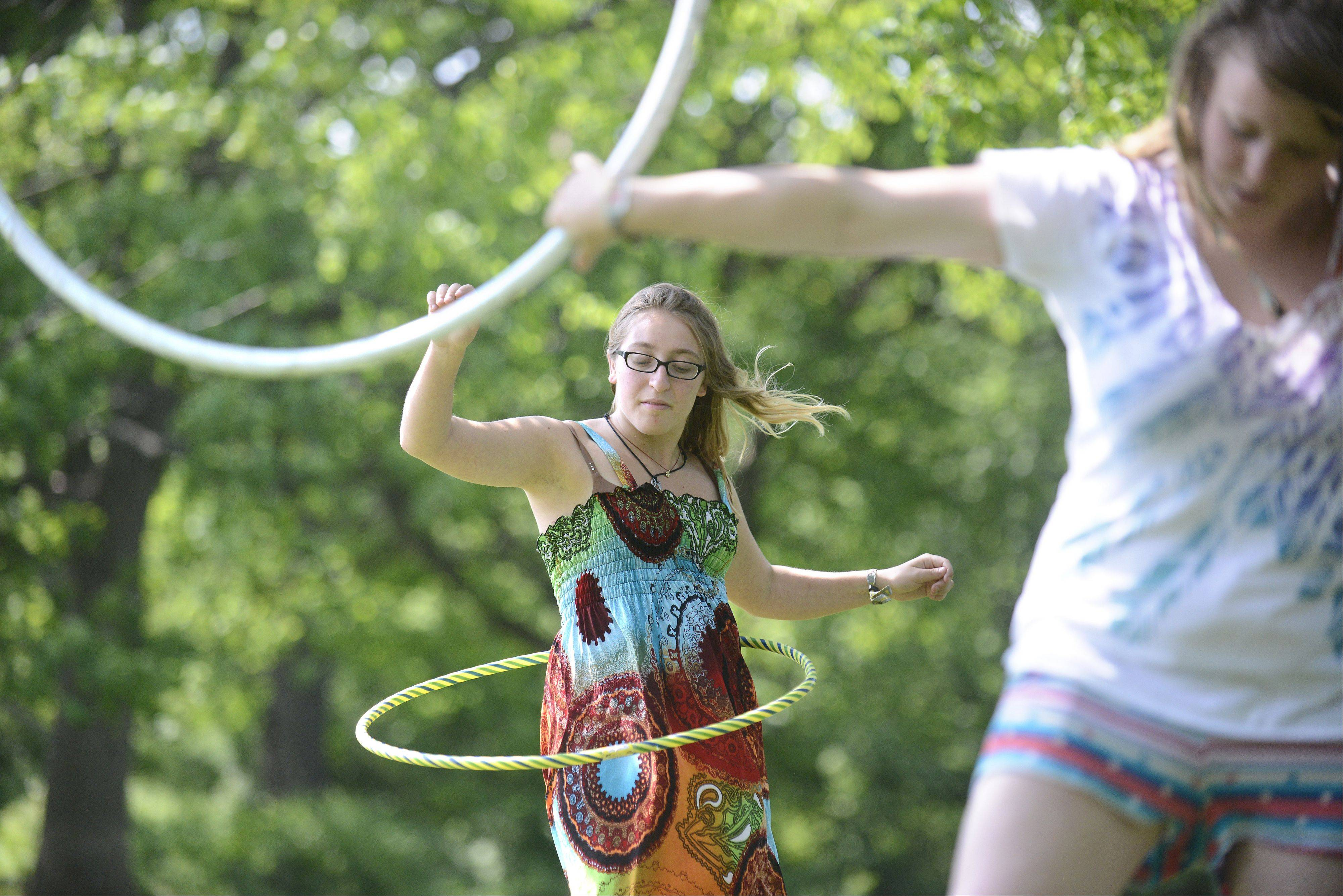 Holly Crowe, 20, of South Elgin, right and Julia Field, 18, of Batavia, hula hoop at LeRoy Oakes Forest Preserve in St. Charles Wednesday afternoon. Crowe has been hooping every day for the past two years. She recently returned from the Chillicothe Music Festival in Chillicothe, Il, where she performed. College students recently out for the summer, Crowe and Field were simply enjoying the day at LeRoy Oakes.