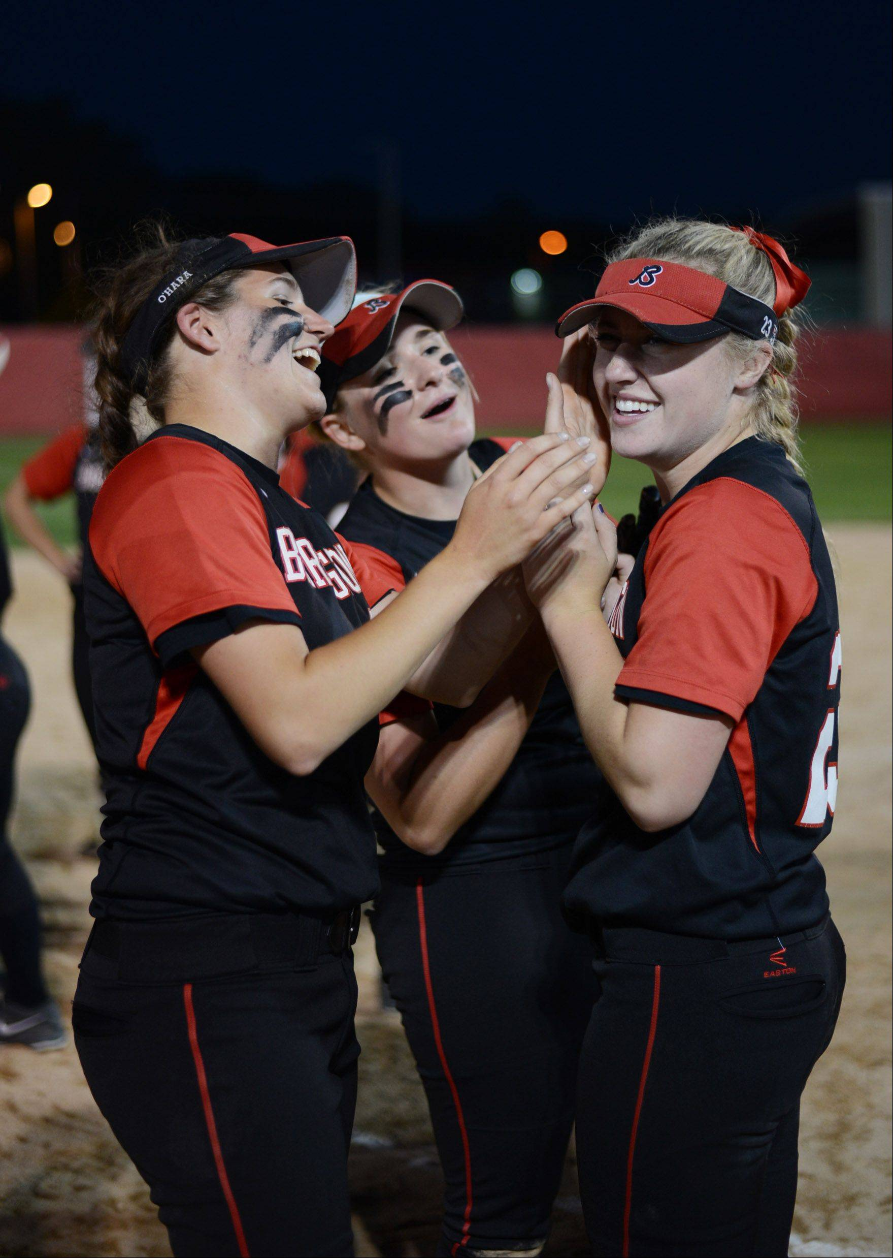Maggie O'Hara, Tess Bolger and Morgan Olszewski shed tears of joy after Barrington's 8-3 victory over Warren in Class 4A supersectional action Monday.