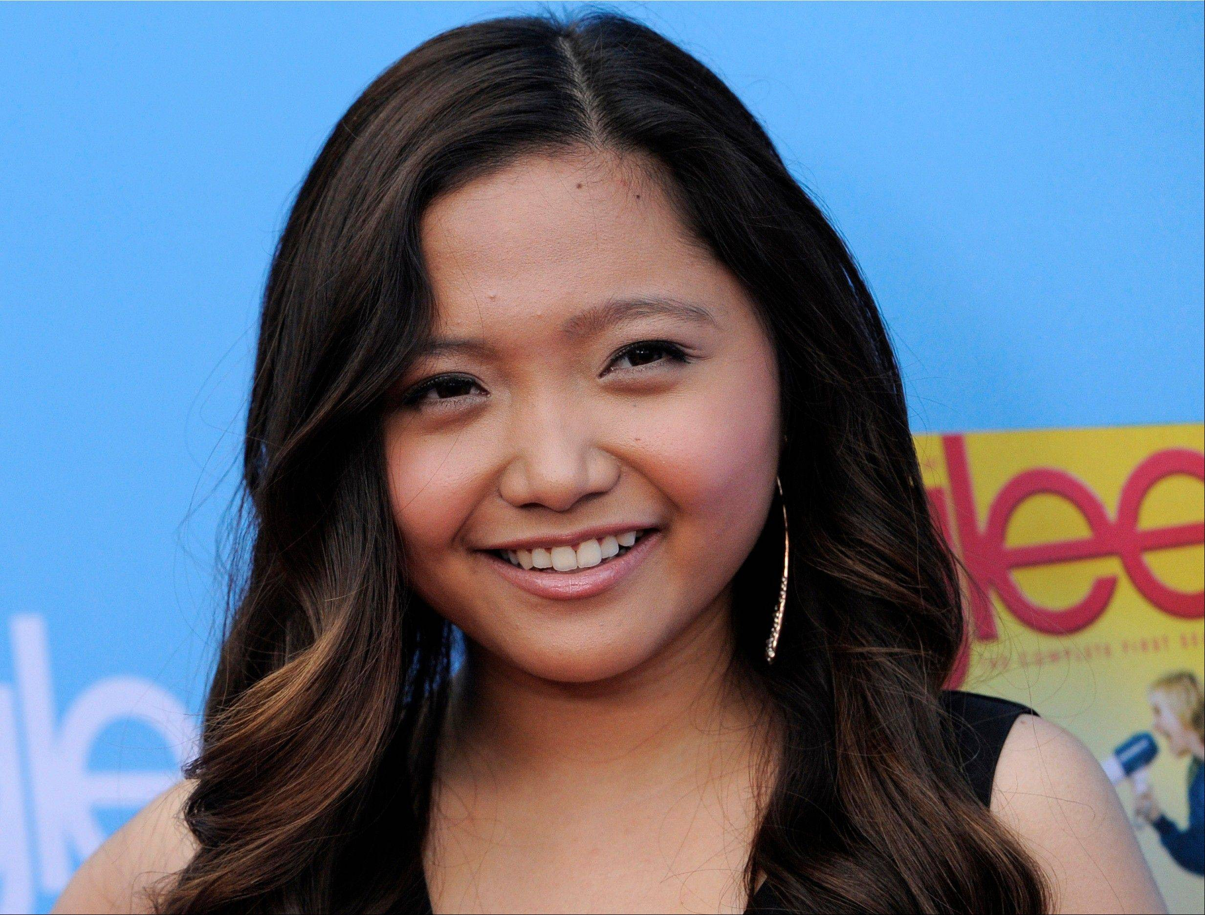 The Filipino singer Charice, who played the role of an exchange student in �Glee,� has come out in an emotional TV interview in which she apologized to her mother and brother.