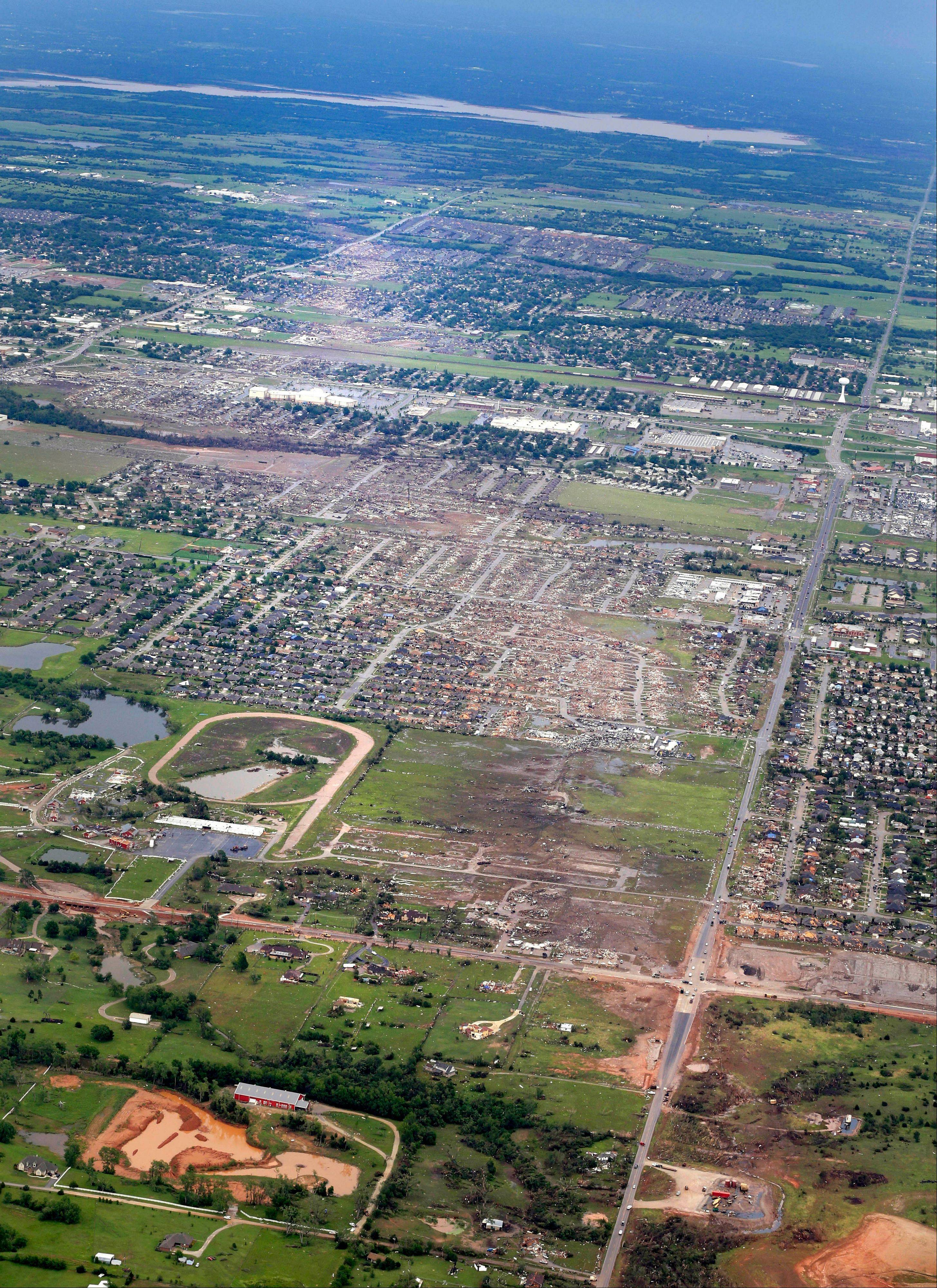 ASSOCIATED PRESS This aerial photo from a day afer the May 20 tornado shows the remains of houses in Moore, Okla. The Oklahoma City area has seen two of the extremely rare EF5 tornadoes in only 11 days. The tornado that hit El Reno had a record-breaking width of 2.6 miles. The one in Moore, a city about 25 miles away from El Reno, killed 24 people and caused widespread damage.