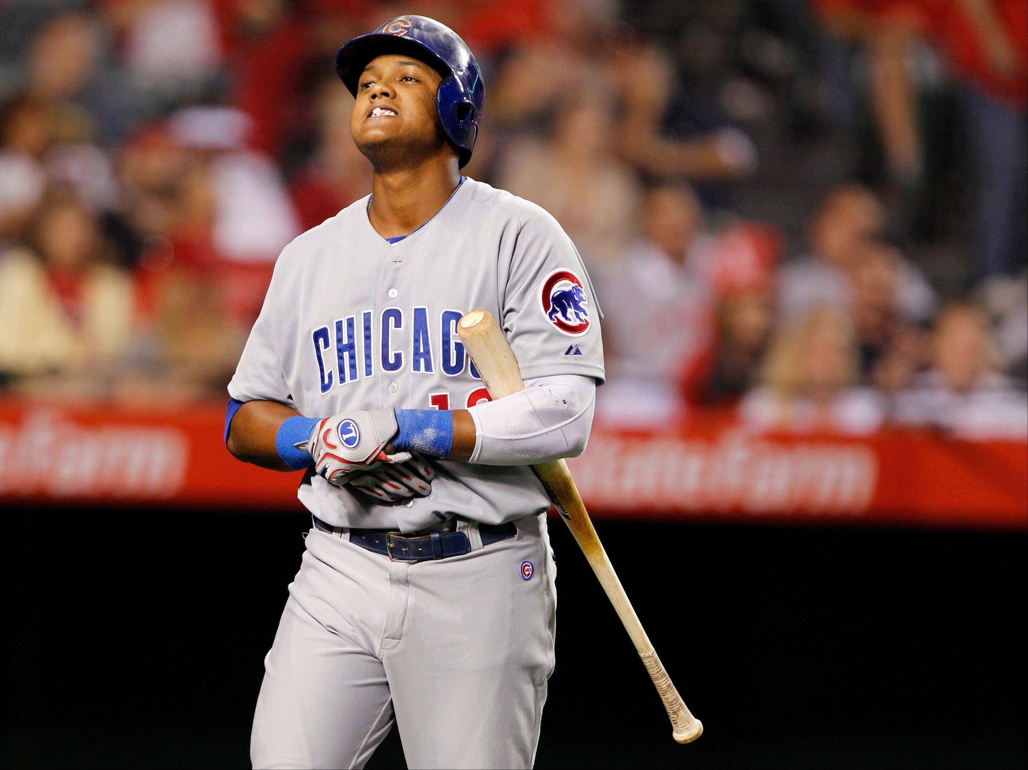 Chicago Cubs shortstop Starlin Castro reacts to hitting a foul ball for an out against the Los Angeles Angels in the sixth inning during an interleague baseball game Tuesday, June 4, 2013, in Anaheim, Calif.