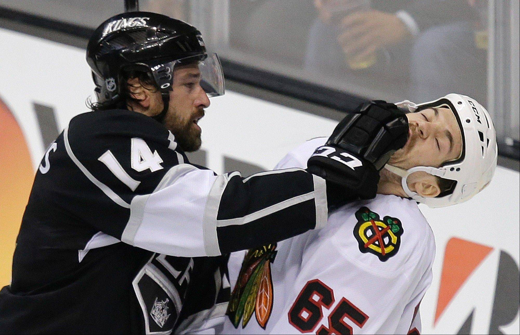 Los Angeles Kings right wing Justin Williams (14) fights with Chicago Blackhawks center Andrew Shaw (65) during the second period of Game 3 of the NHL hockey Stanley Cup playoffs Western Conference finals, Tuesday, June 4, 2013 in Los Angeles.