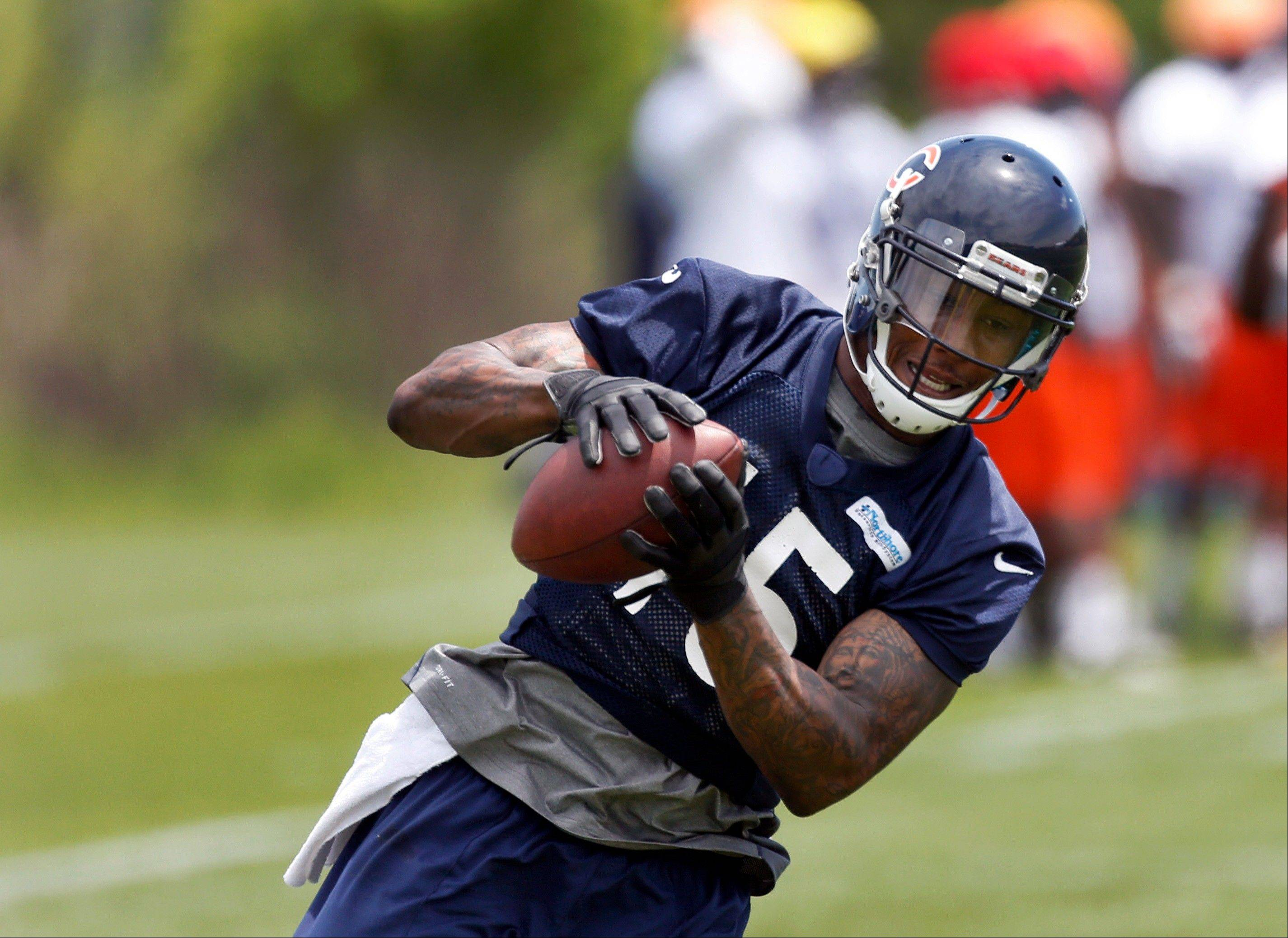 Bears wide receiver Brandon Marshall catches a pass during the Bears' NFL football practice Tuesday, June 4, 2013, in Lake Forest, Ill. Marshall returned to the field after his rehabilitation from hip surgery.