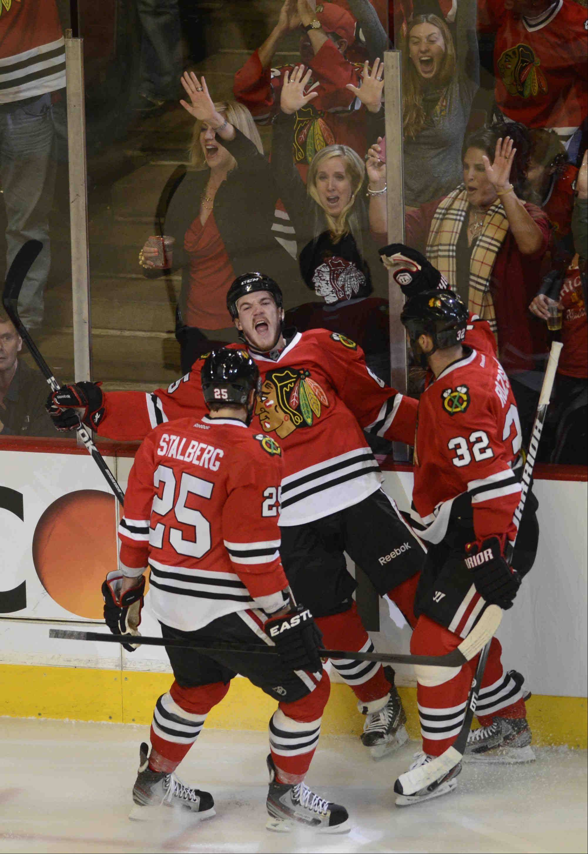Blackhawks center Andrew Shaw celebrates his first-period goal against the Los Angeles Kings during Game 2 of the NHL Western Conference finals at the United Center Sunday night in Chicago.