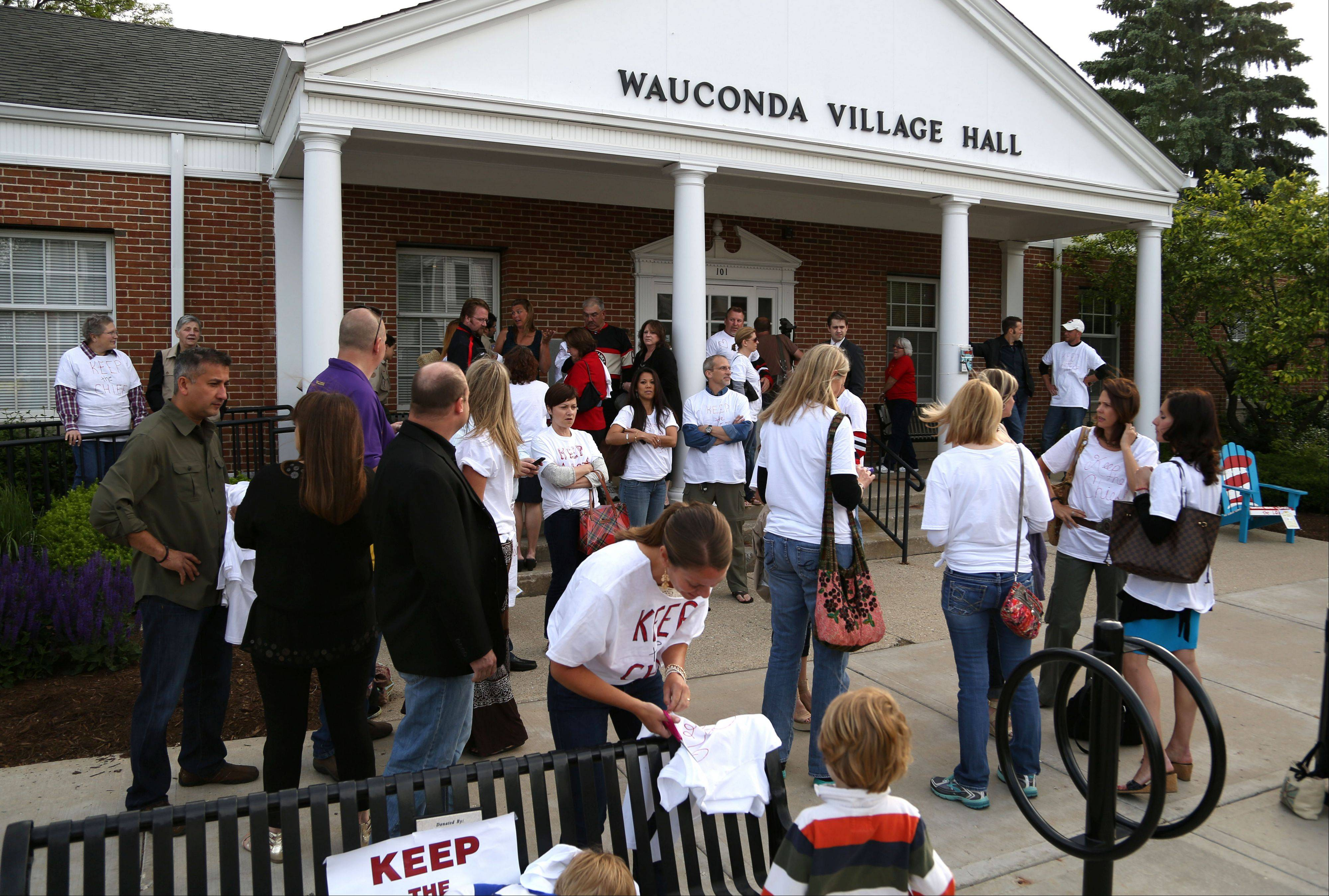"Members of the ""Keep the Chief"" campaign gathered outside Wauconda's village hall Tuesday to support Police Chief Doug Larsson."
