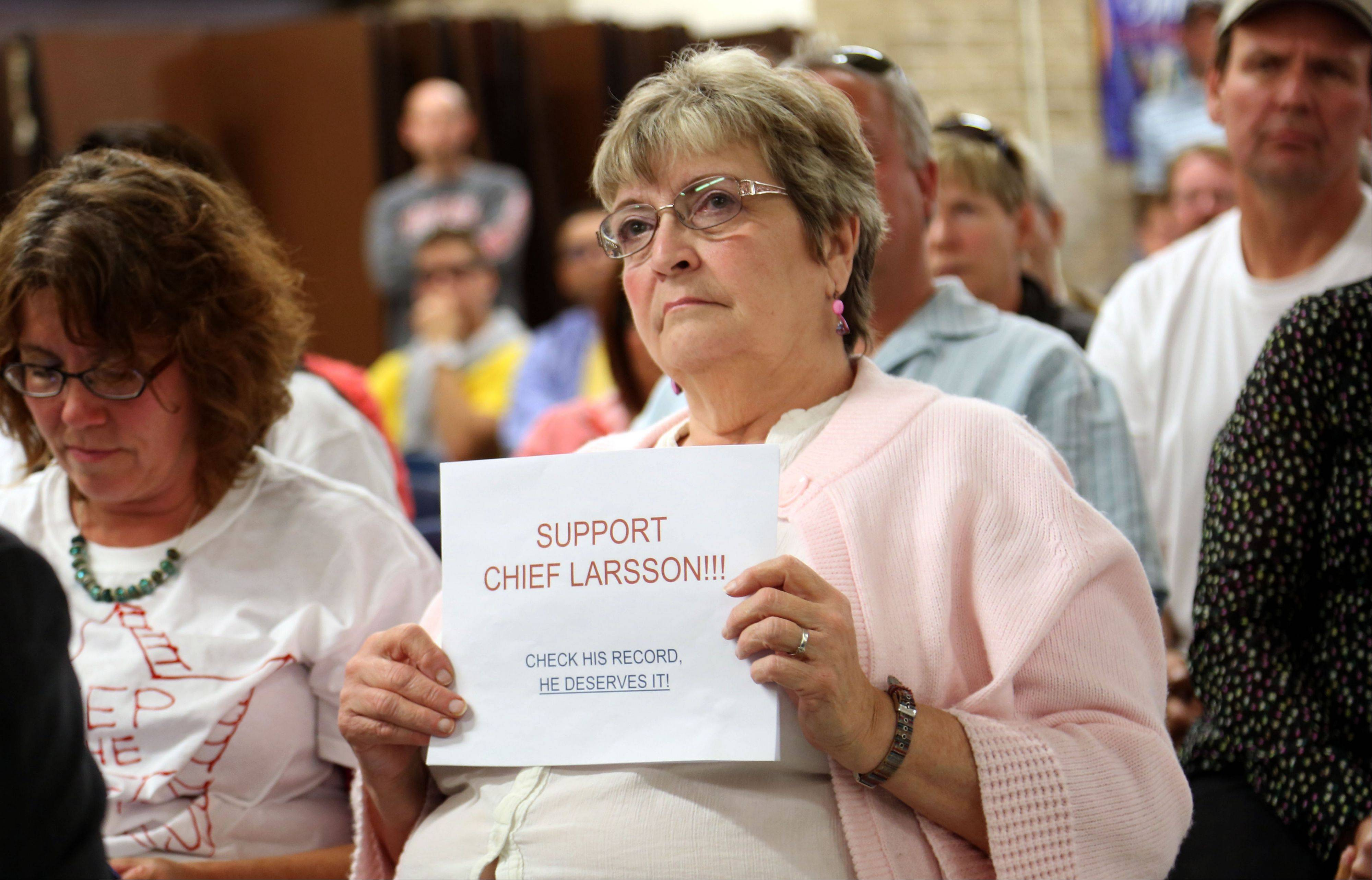Connie Colson of Wauconda shows her support for Wauconda Police Chief Doug Larsson during the village board meeting Tuesday night at Wauconda High School.