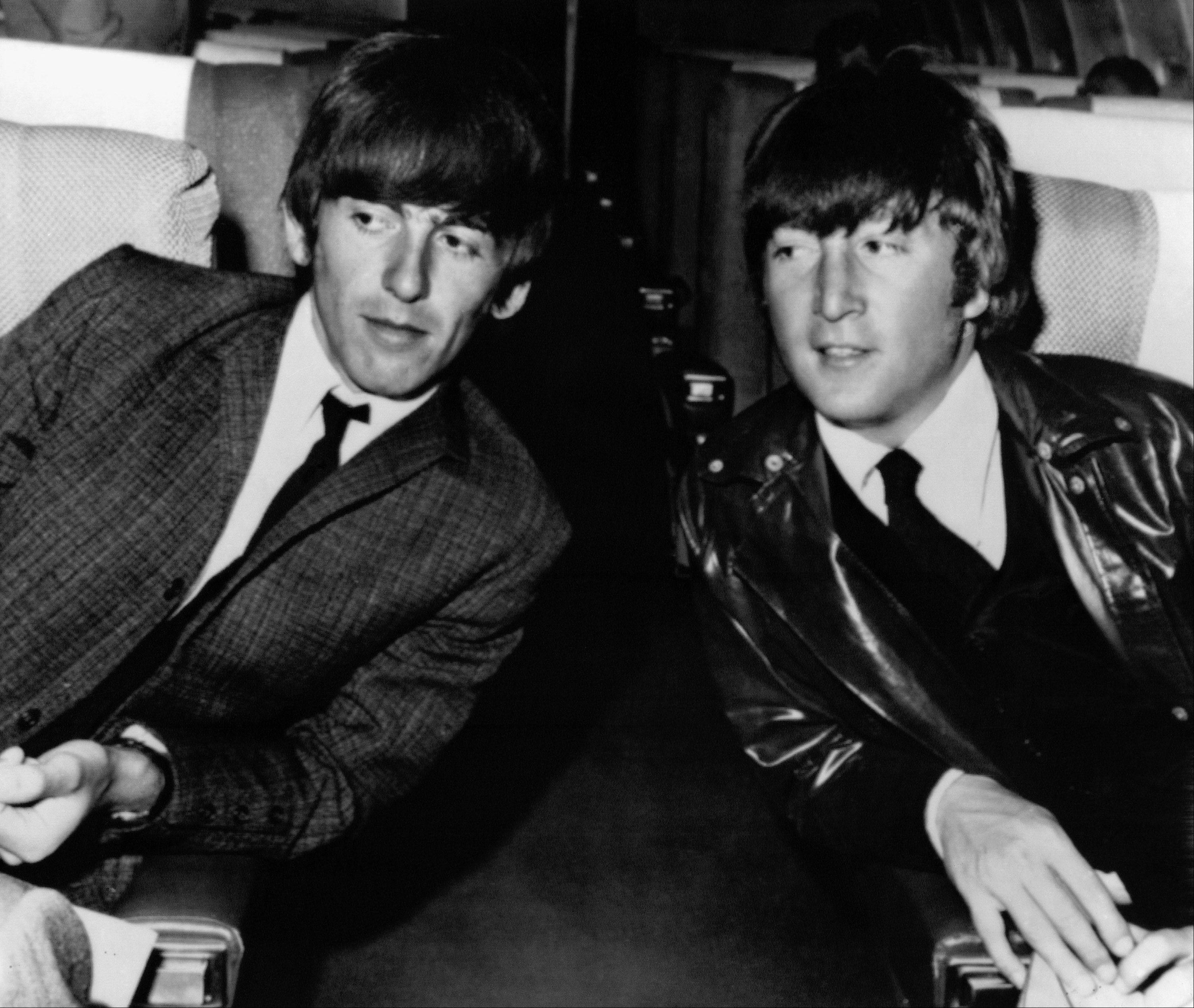 Beatles George Harrison, left, and John Lennon sit aboard an airplane in Los Angeles before leaving for London in 1964. A year earlier, Harrison visited the southern Illinois town of Benton to visit his sister, Linda Harrison Caldwell.