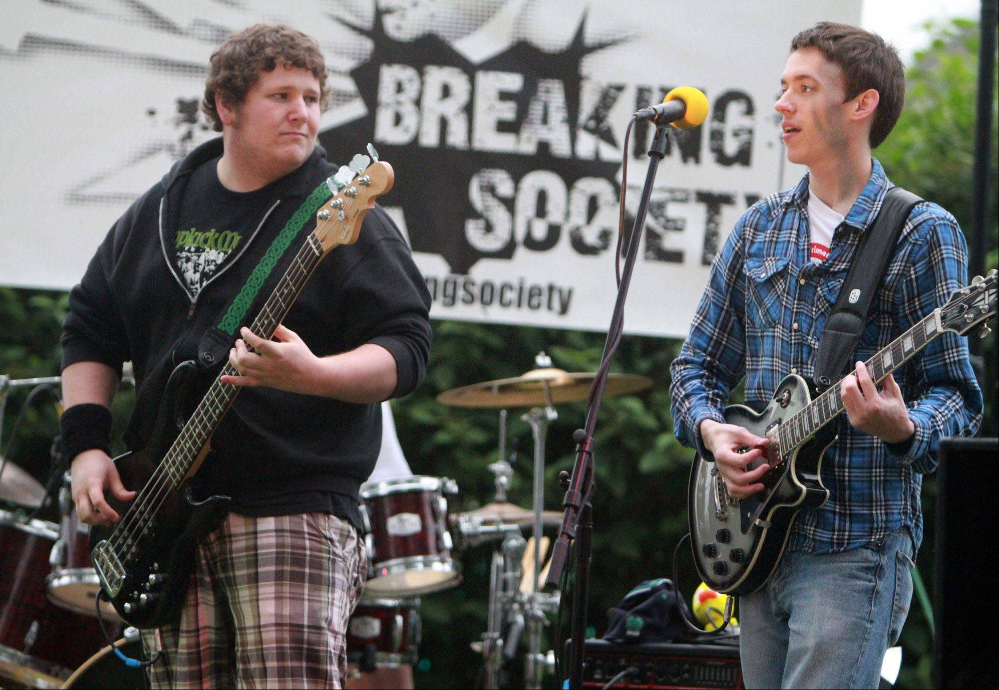 Patrick McCommons, left, and Rob Kerpan with the band Breaking Society perform at Teen Night during the Celebration of Summer in Lake Villa.