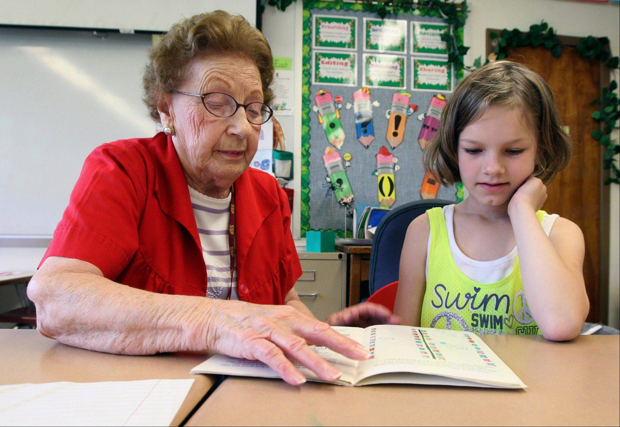 Foster grandparent Meda Miller reads with Lovejoy Elementary School second-grader Willow Bates, 8, in her Alton classroom.