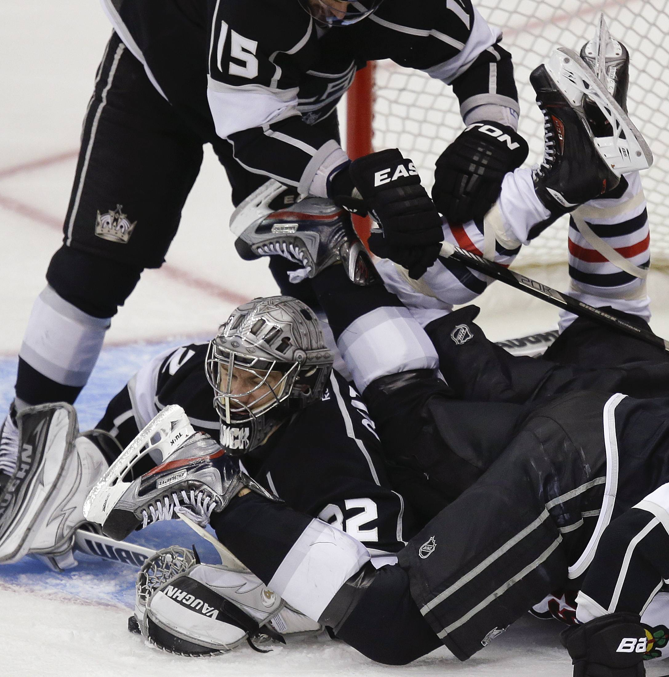 Los Angeles Kings goalie Jonathan Quick (32) gets tangled up in the crease during the second period against the Chicago Blackhawks during Game 3 of the NHL hockey Stanley Cup playoffs Western Conference finals, Tuesday, June 4, 2013, in Los Angeles.