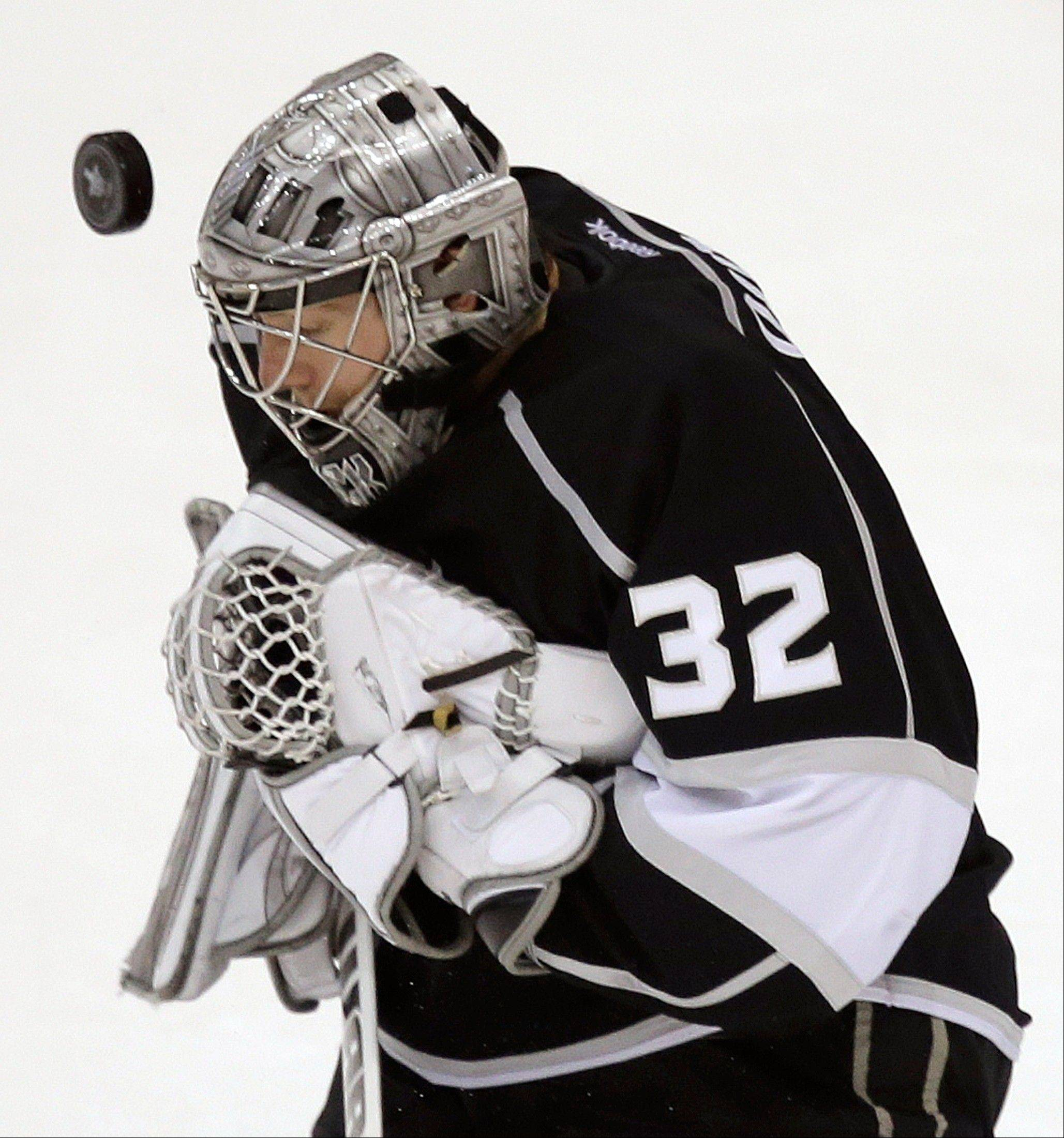 Los Angeles Kings goalie Jonathan Quick blocks a shot by the Chicago Blackhawks during the first period of Game 3 of the NHL hockey Stanley Cup playoffs Western Conference finals, Tuesday, June 4, 2013, in Los Angeles.