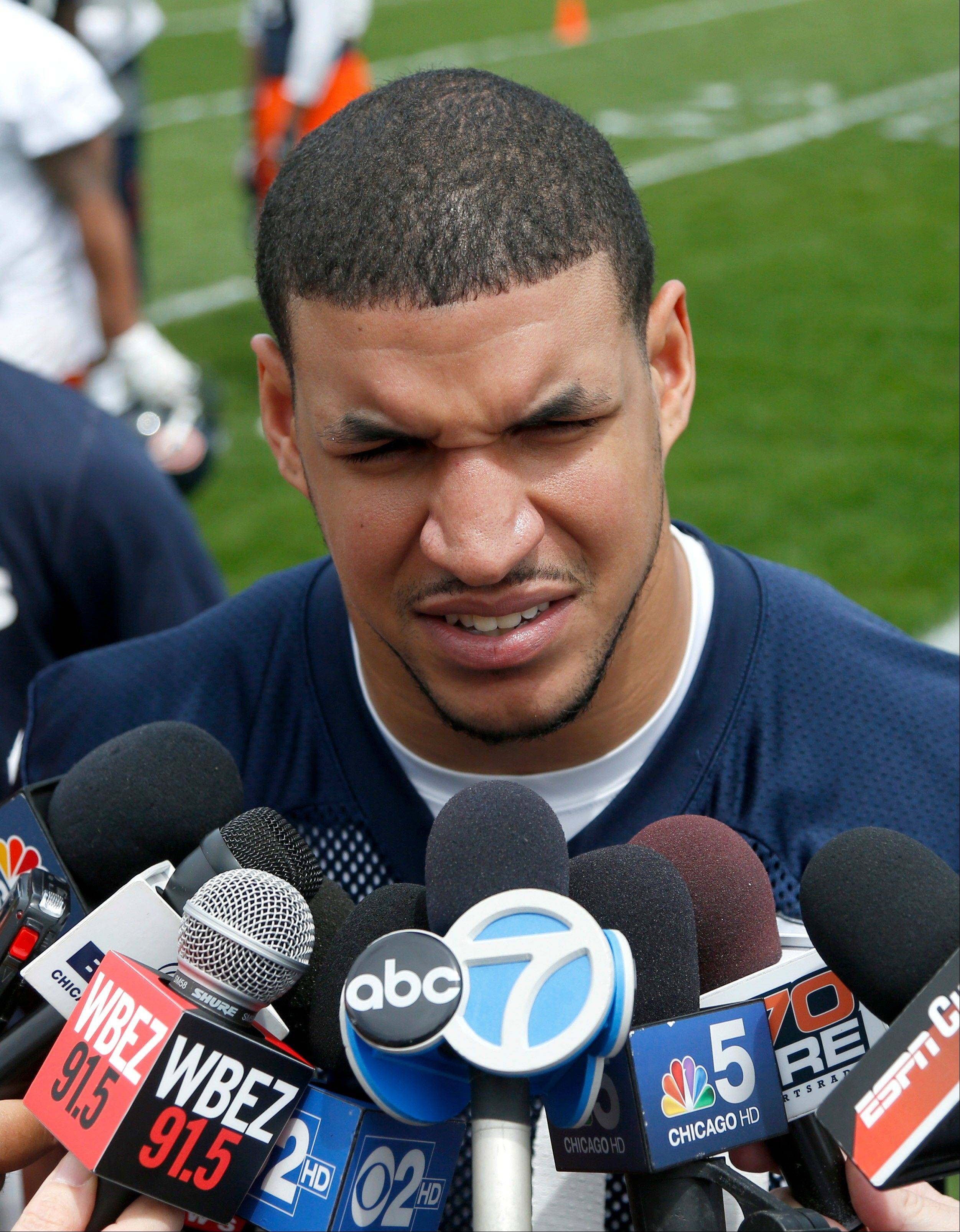 Bears tight end/fullback Evan Rodriguez talks with reporters after the NFL football team's practice Tuesday, June 4, 2013, in Lake Forest, Ill. Authorities say Rodriguez was ticketed for driving under the influence, speeding and improper lane usage and was ticketed early Friday on Interstate 90, near downtown Chicago.