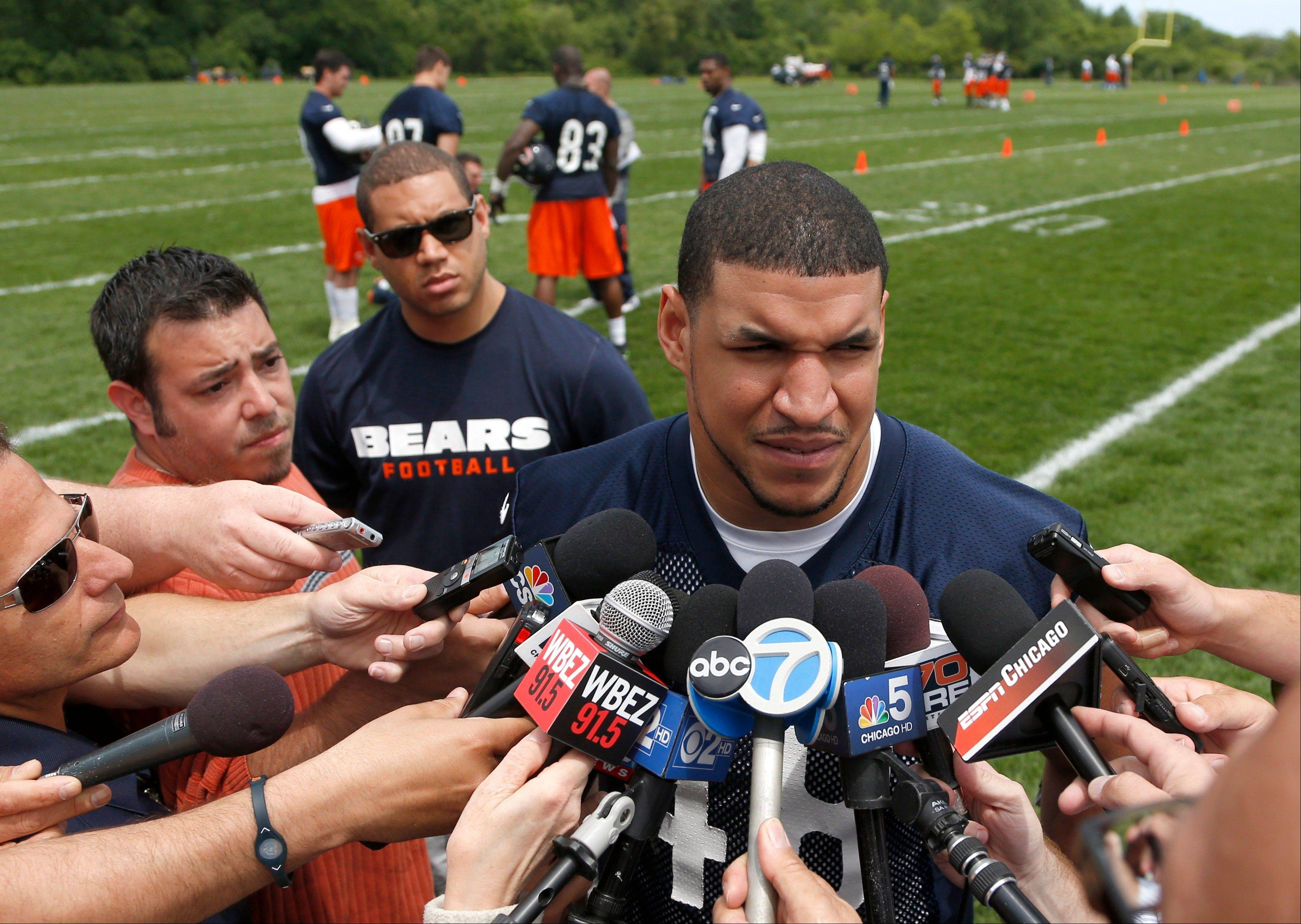 The Bears' Evan Rodriguez talks with reporters Tuesday after practice in Lake Forest. Authorities say Rodriguez was ticketed for driving under the influence, speeding and improper lane usage and was ticketed early Friday on Interstate 90, near downtown Chicago. The incident was the second encounter the 24-year-old Rodriguez has had with police this year. In March, Rodriguez was charged with disorderly intoxication and resisting an officer in Miami. Those charges were eventually dropped.
