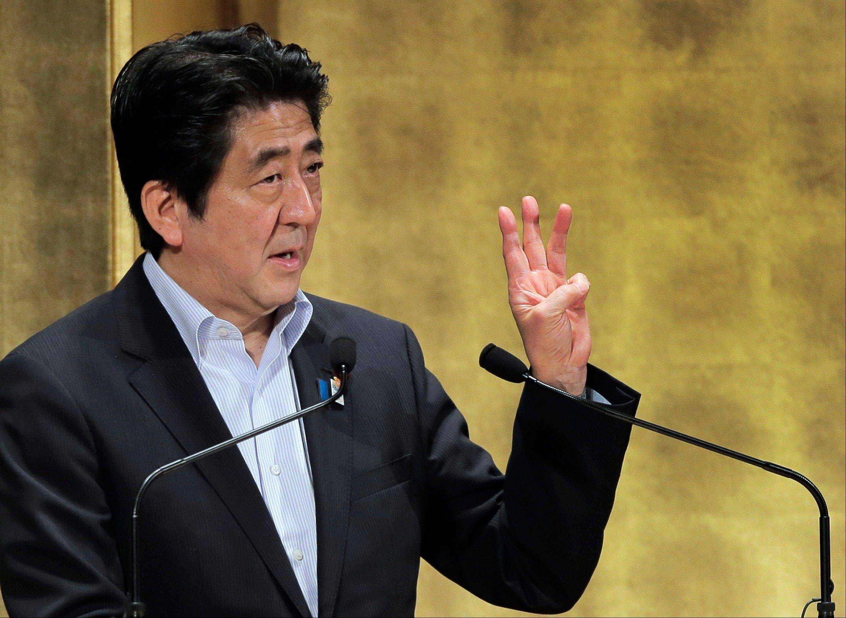 Japanese Prime Minister Shinzo Abe gestures Wednesday during a speech at a seminar in Tokyo. Abe outlined a sweeping blueprint for rejuvenating Japan�s ailing economy with reforms meant to bring more women into the workforce, promote industrial innovation and coax cash-hoarding corporations into investing more.