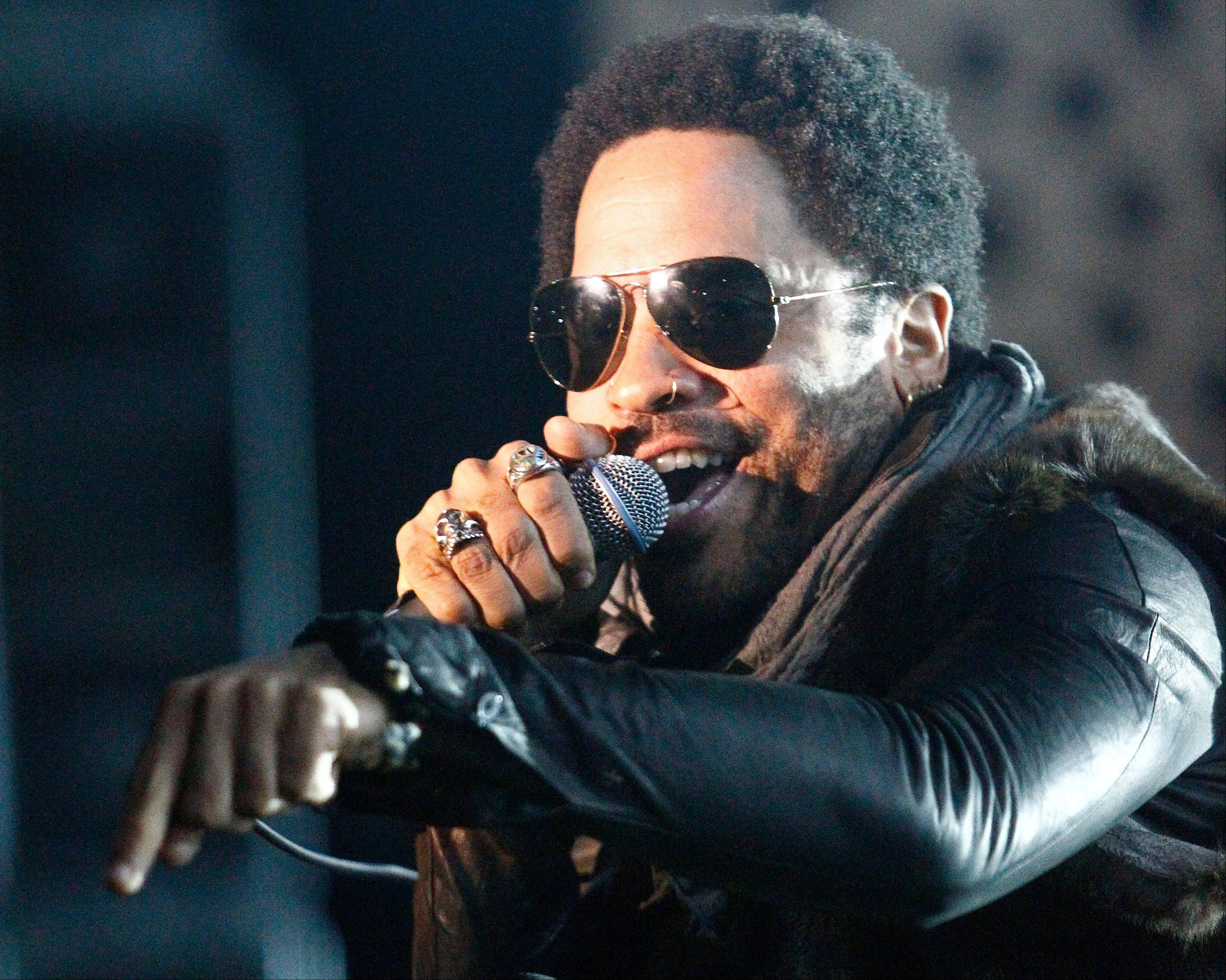 Singer Lenny Kravitz will join co-host Jason Aldean, while rapper Nelly will team with Florida Georgia Line on their crossover hit �Cruise� during Wednesday night�s CMT Music Awards show.