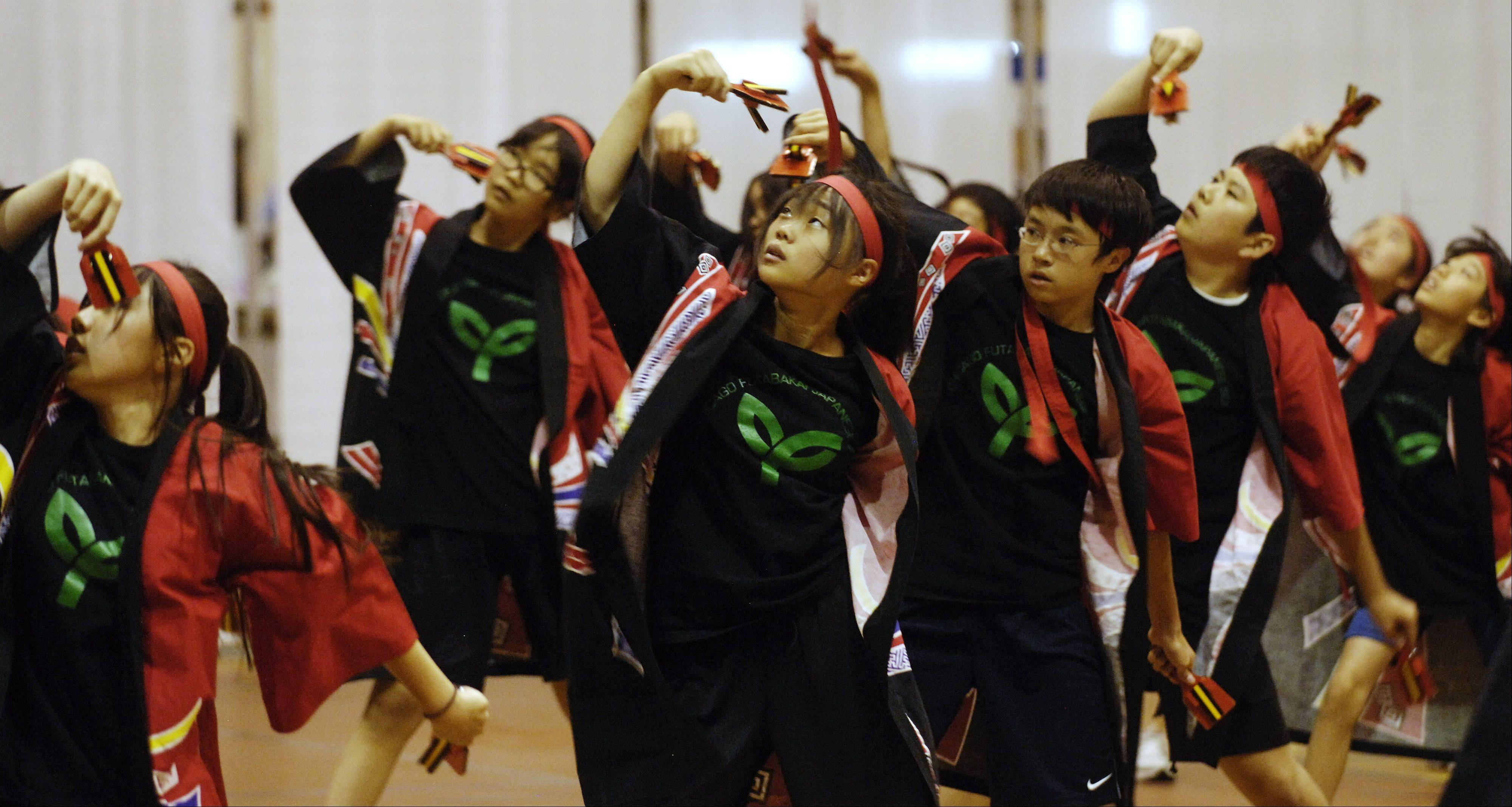 The Chicago Futabakai Japanese School performs a Soran Dance during the 30th anniversary Japan Festival in 2012.