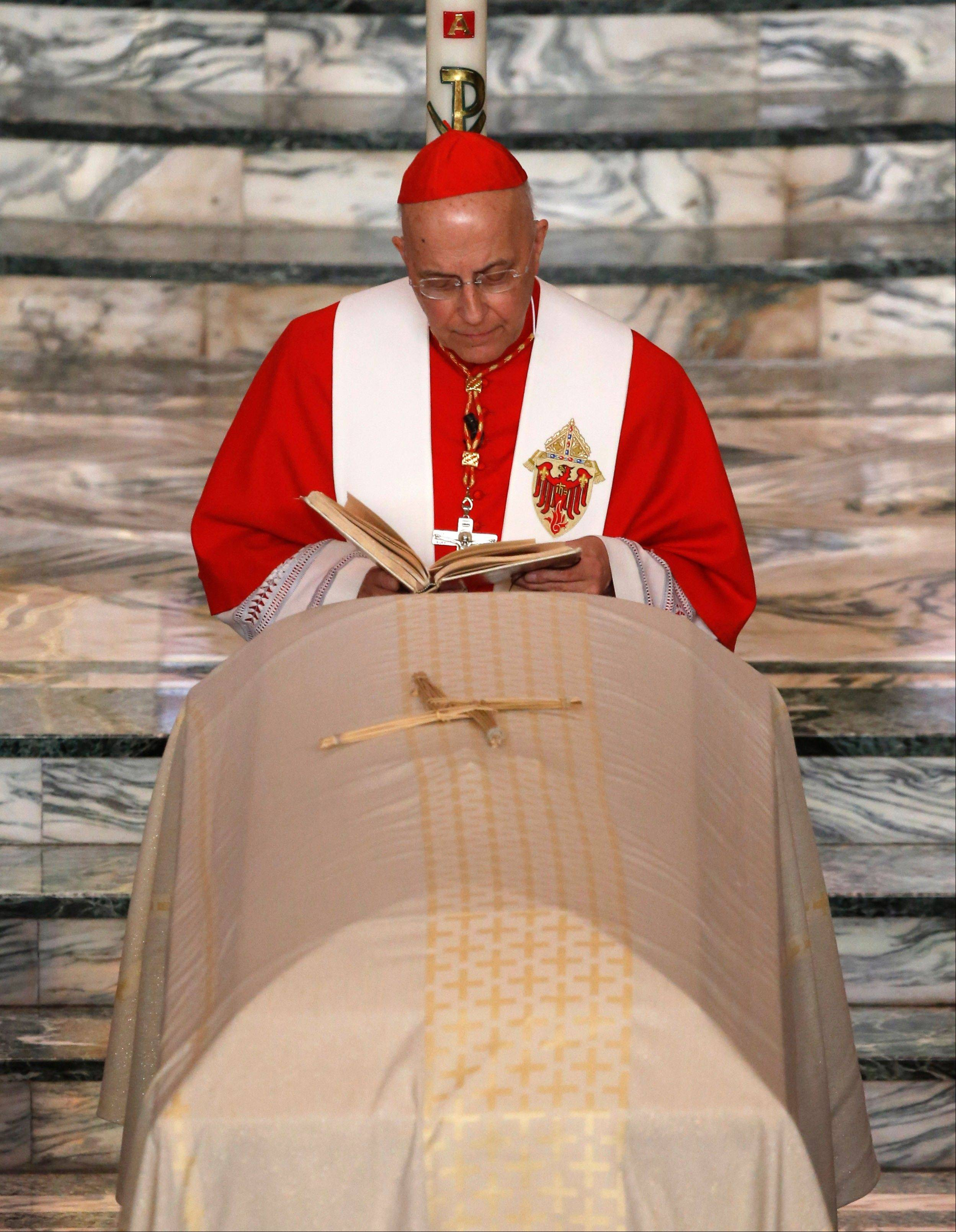 Francis Cardinal George presides over a funeral Mass for the Rev. Andrew Greeley at Christ The King Church Wednesday, June 5, 2013, in Chicago. Greeley, an outspoken priest and best-selling author died in his Chicago home last week he was 85.