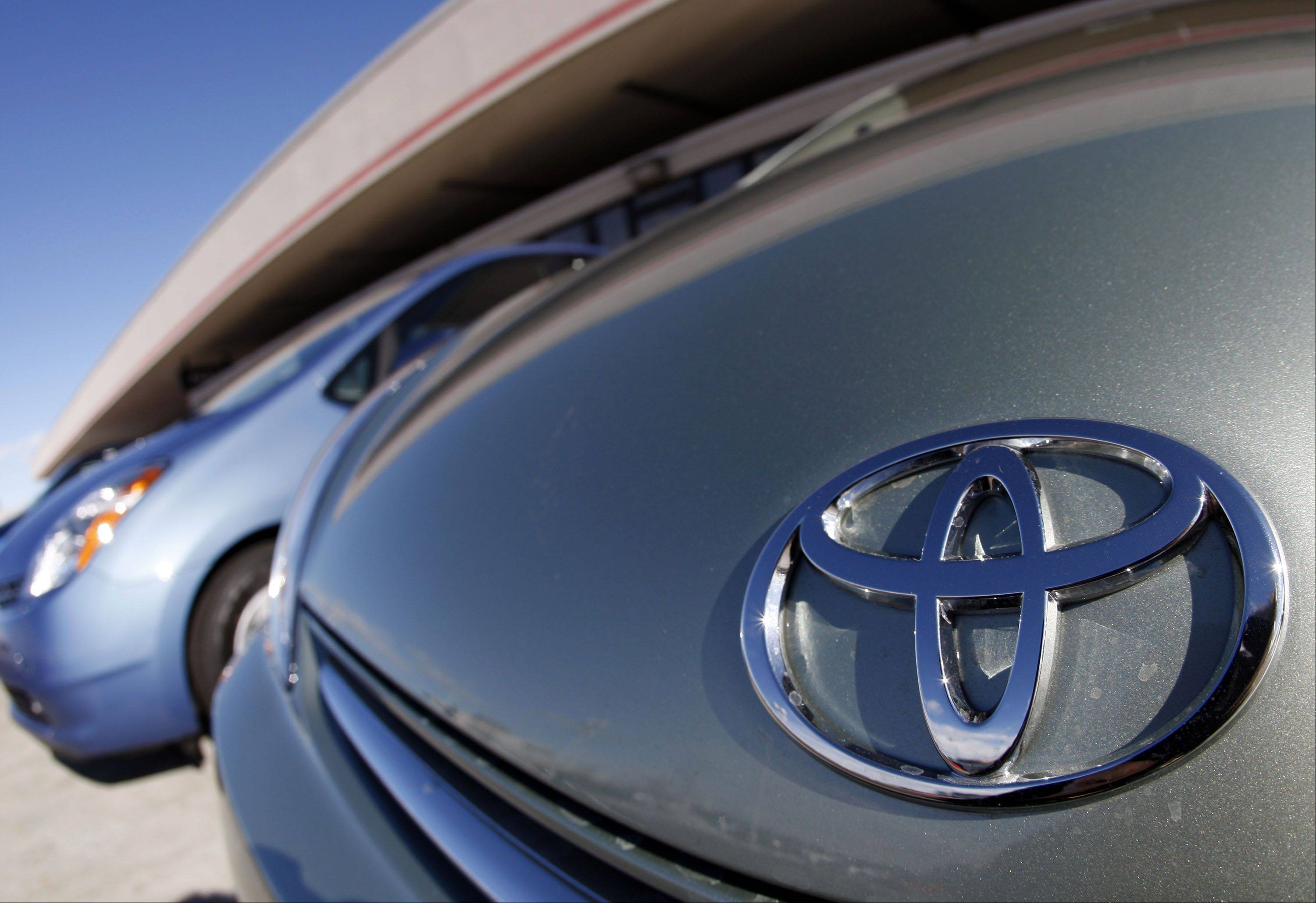 Toyota Motor Corp. said Wednesday it is recalling about 242,000 of its Prius and Lexus hybrid vehicles due to problems with their braking systems.