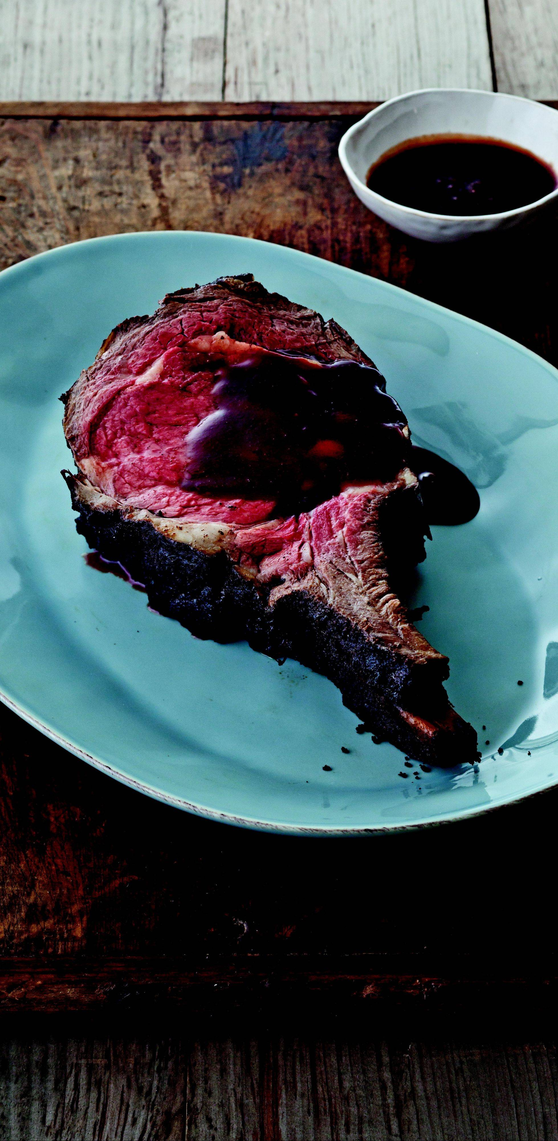 Patience pays tasty dividends with a tender slab of Smoked Prime Rib with Red Wine Steak Sauce.