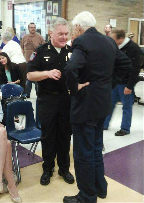 Wauconda Police Chief Douglas Larsson talks with a supporter before Tuesday night's meeting at Wauconda High School.