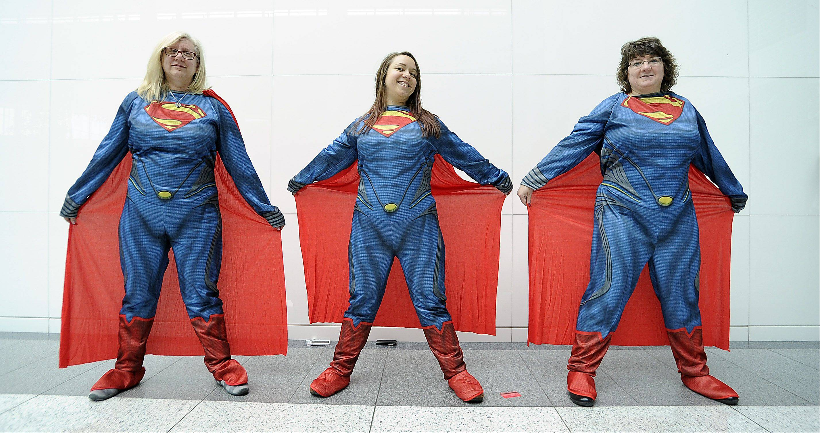 Jan Somers of Lake Zurich, Jamie Becker of Wheaton and Kim Lachman of Lake in the Hills strike a pose as Superman.