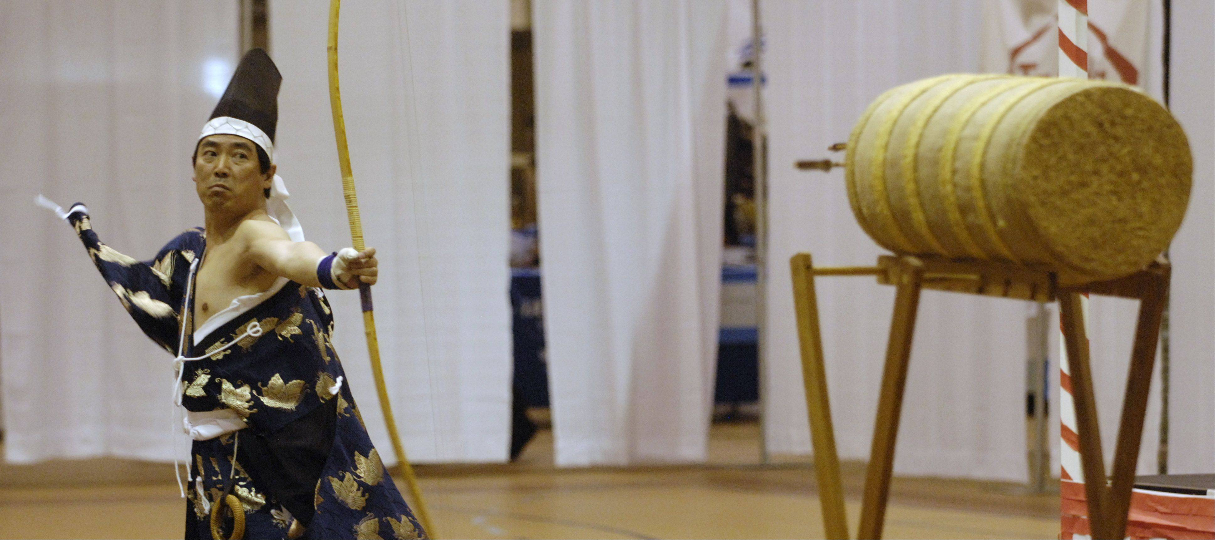 Yasuo Ito demonstrates Reisha, ceremonial archery, at the 2012 festival at Forest View Educational Center, in Arlington Heights. This year's fest has been moved to Elk Grove High School.