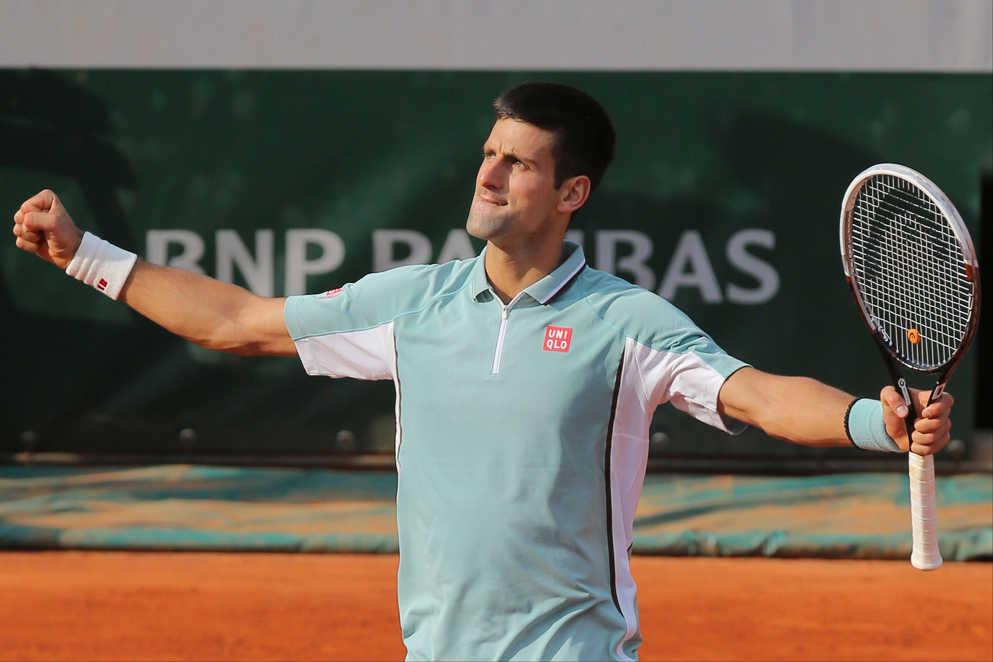 Serbia's Novak Djokovic celebrates defeating Germany's Tommy Haas in three sets 6-3, 7-6, 7-5, in their quarterfinal match at the French Open tennis tournament, at Roland Garros stadium in Paris, Wednesday June 5, 2013.