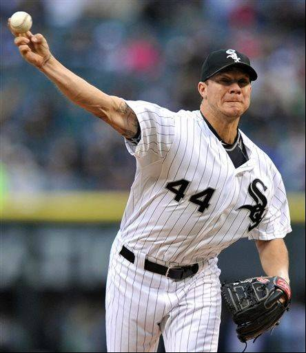 Chicago White Sox starter Jake Peavy delivers a pitch during the first inning of an interleague baseball game against the Miami Marlins in Chicago, Saturday, May 25, 2013.