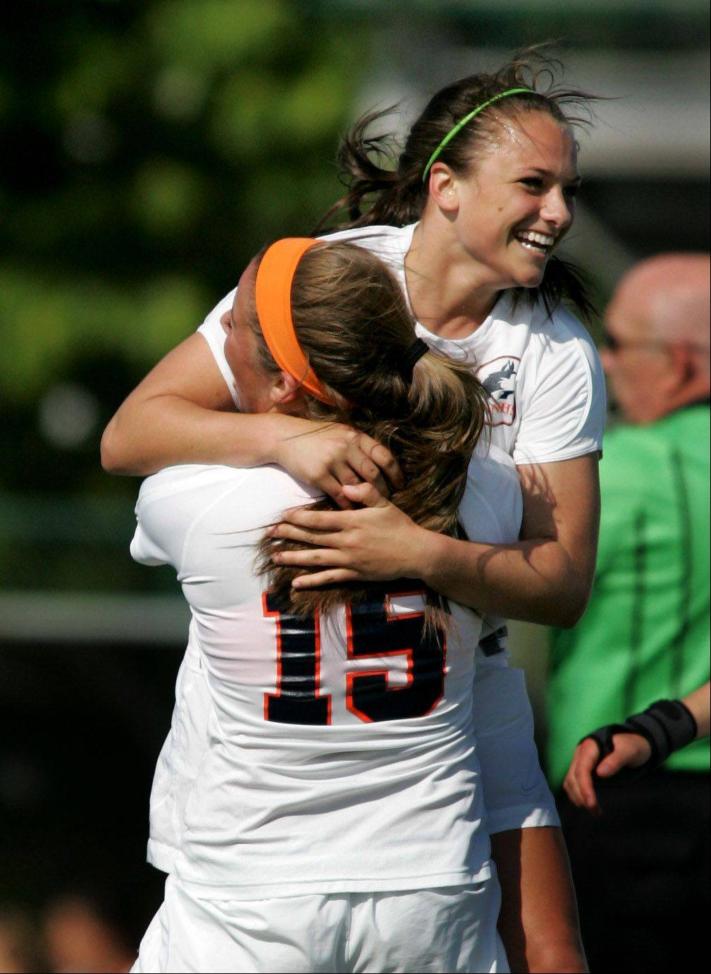 Bev Horne/bhorne@dailyherald.com � Christa Szalach of Naperville North gets a hug from teammate Cora Climo (15) after her goal in the first half against Naperville Central in Class 3A Waubonsie Valley sectional semifinal girls soccer Tuesday in Aurora.