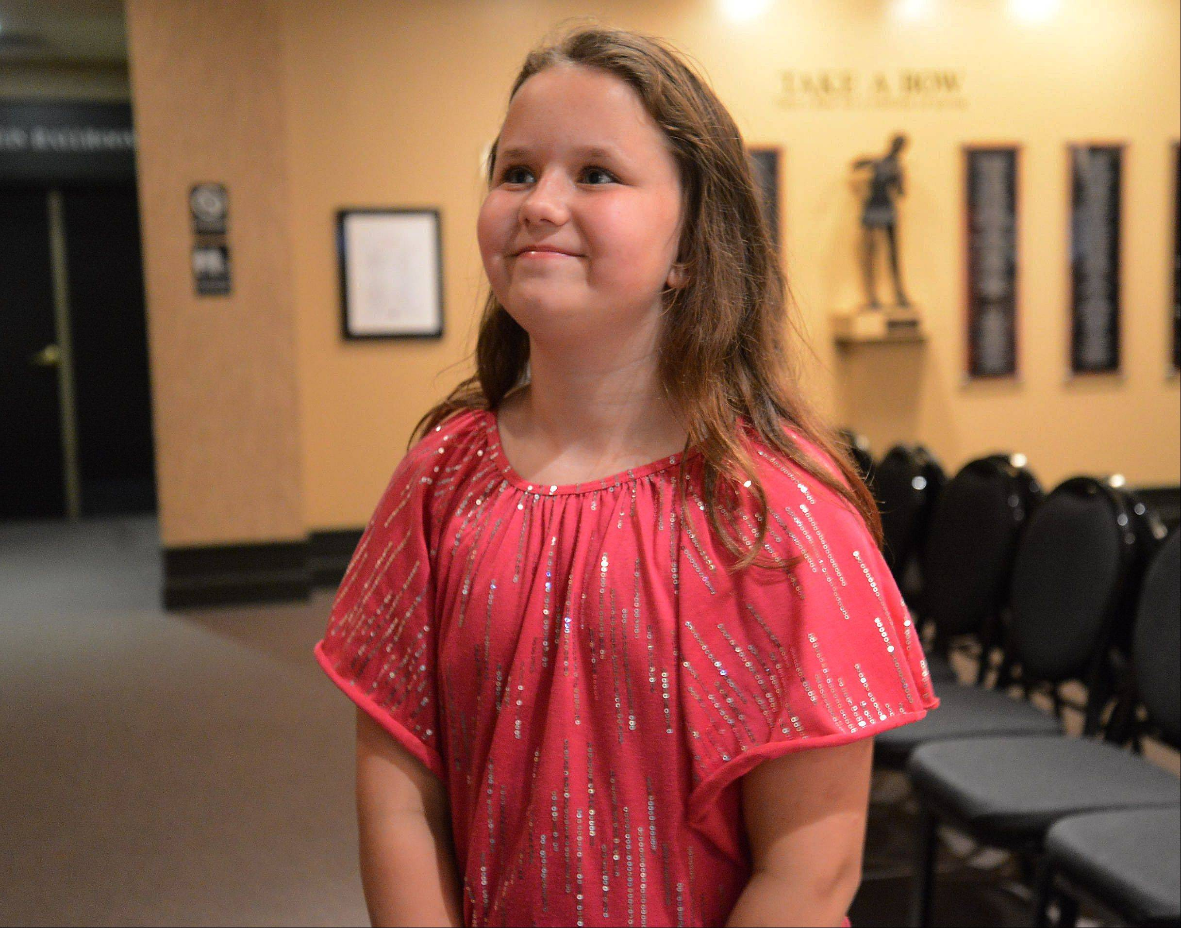 10-year-old Mary Hilbrink of Fox River Grove is pleased after her performance.