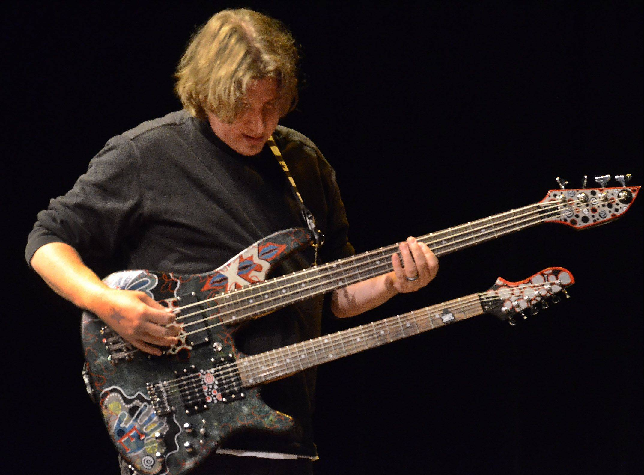 "Dave Siemiaszko of Wheeling, wields his custom made double neck guitar he calls ""The Beast."""