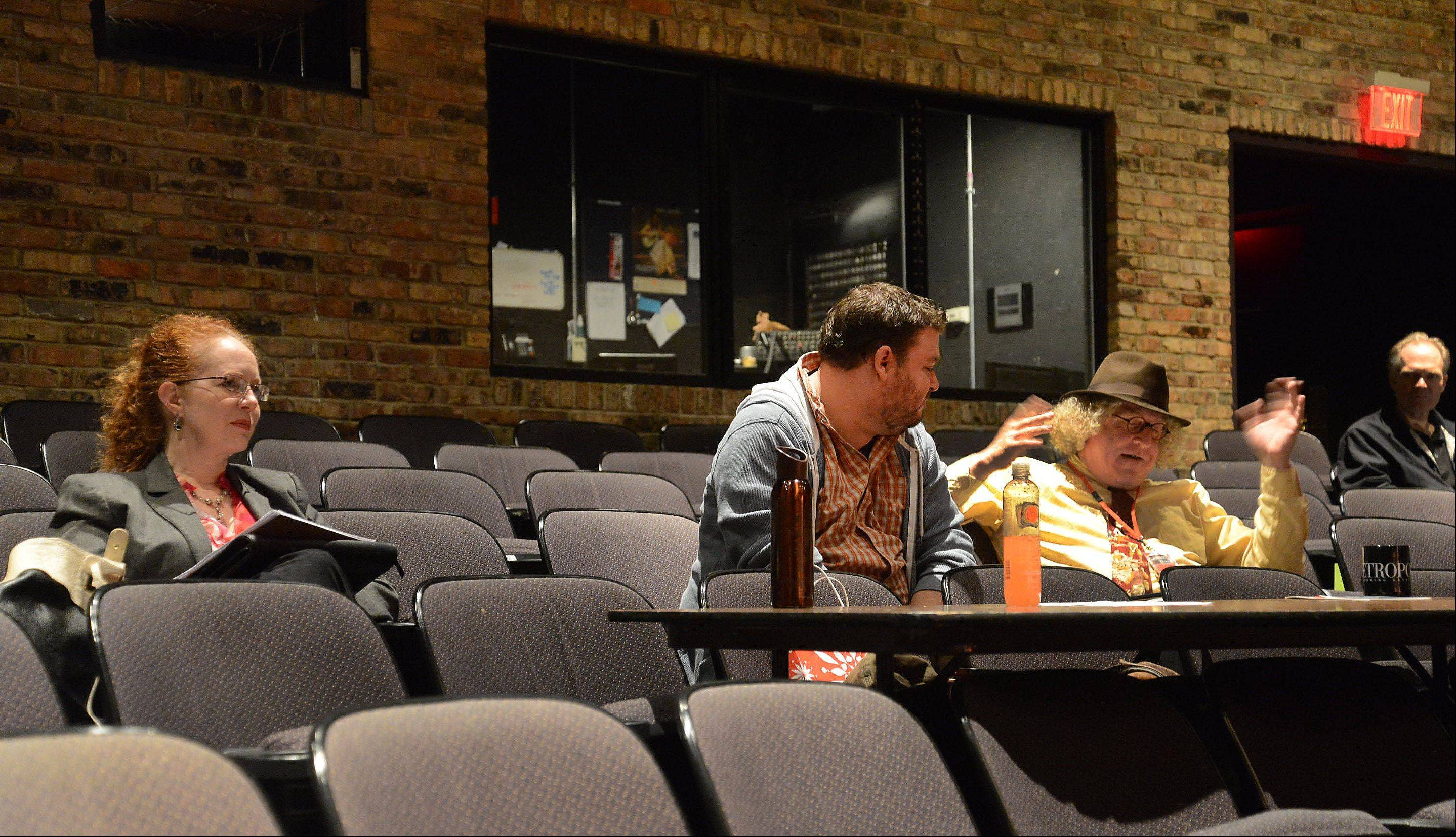 From left, Robin Hughes, Micky York and Charlie Beck critique one of the opening day acts.