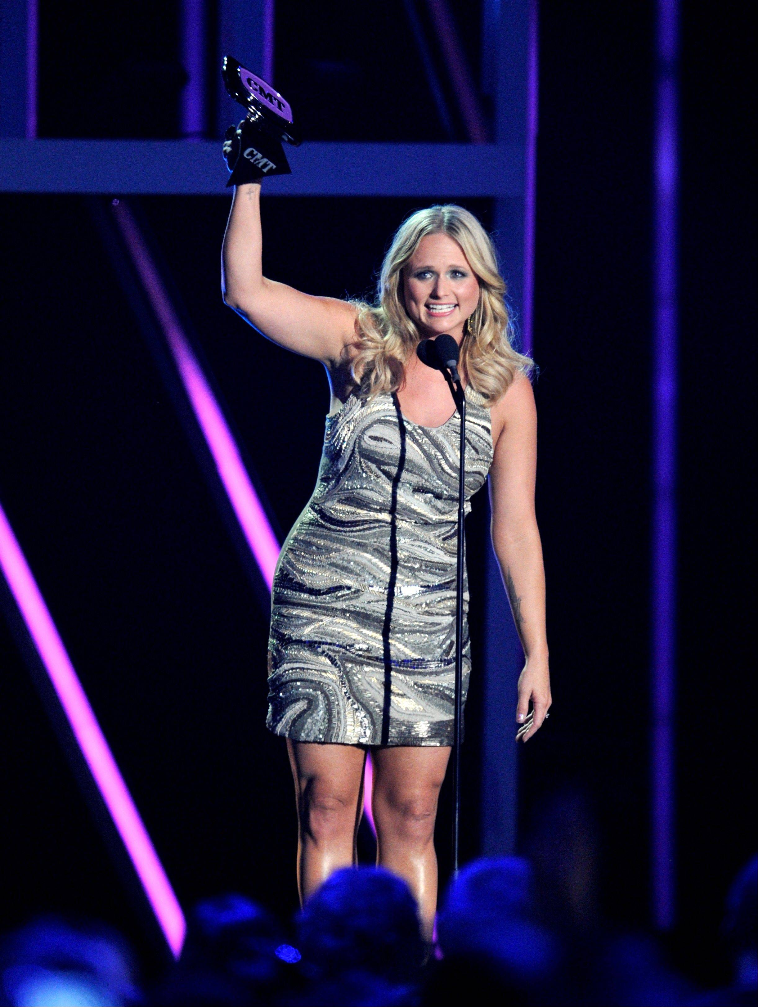 "Miranda Lambert accepts the award for female video of the year for ""Mama's Broken Heart"" at the 2013 CMT Music Awards Wednesday."