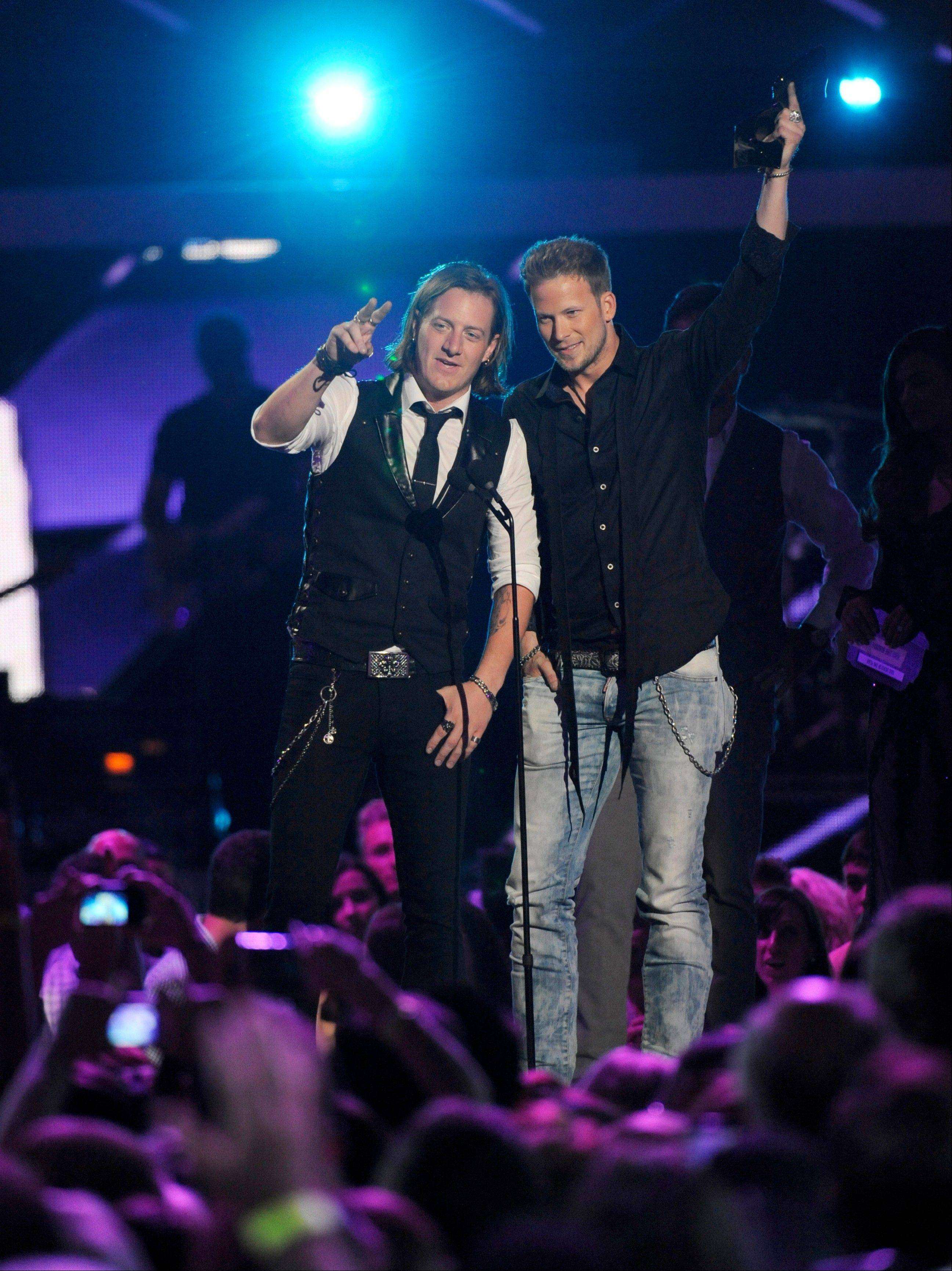 "Tyler Hubbard, left, and Brian Kelley of Florida Georgia Line accept the award for duo video of the year for ""Cruise"" at the 2013 CMT Music Awards."