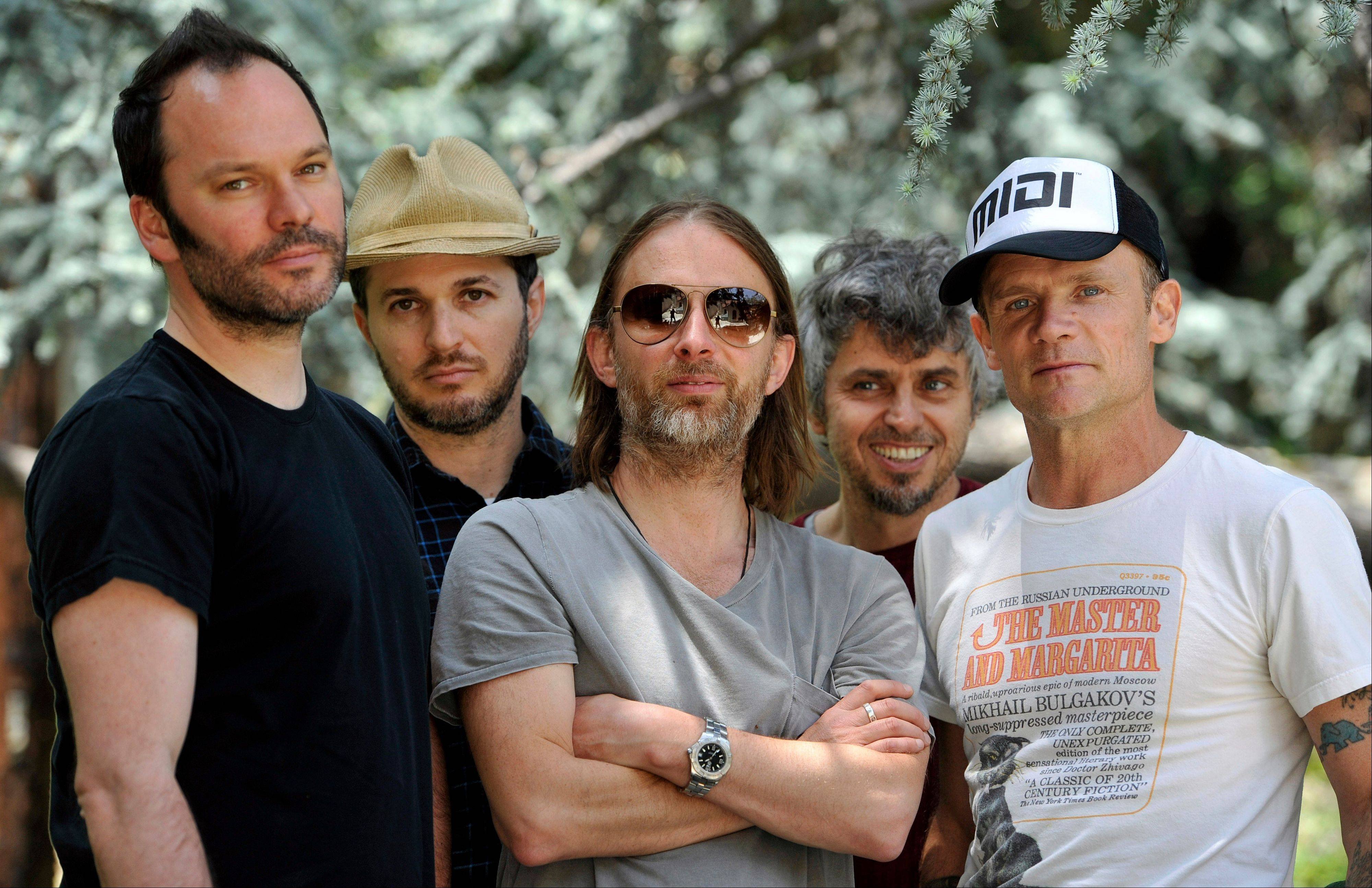 Atoms For Peace -- Nigel Godrich, left, Joey Waronker, Thom Yorke, Mauro Refosco and Flea -- are currently in rehearsals for the band's 27-date tour, which begins in July in Europe and stops in Chicago on Oct. 2.