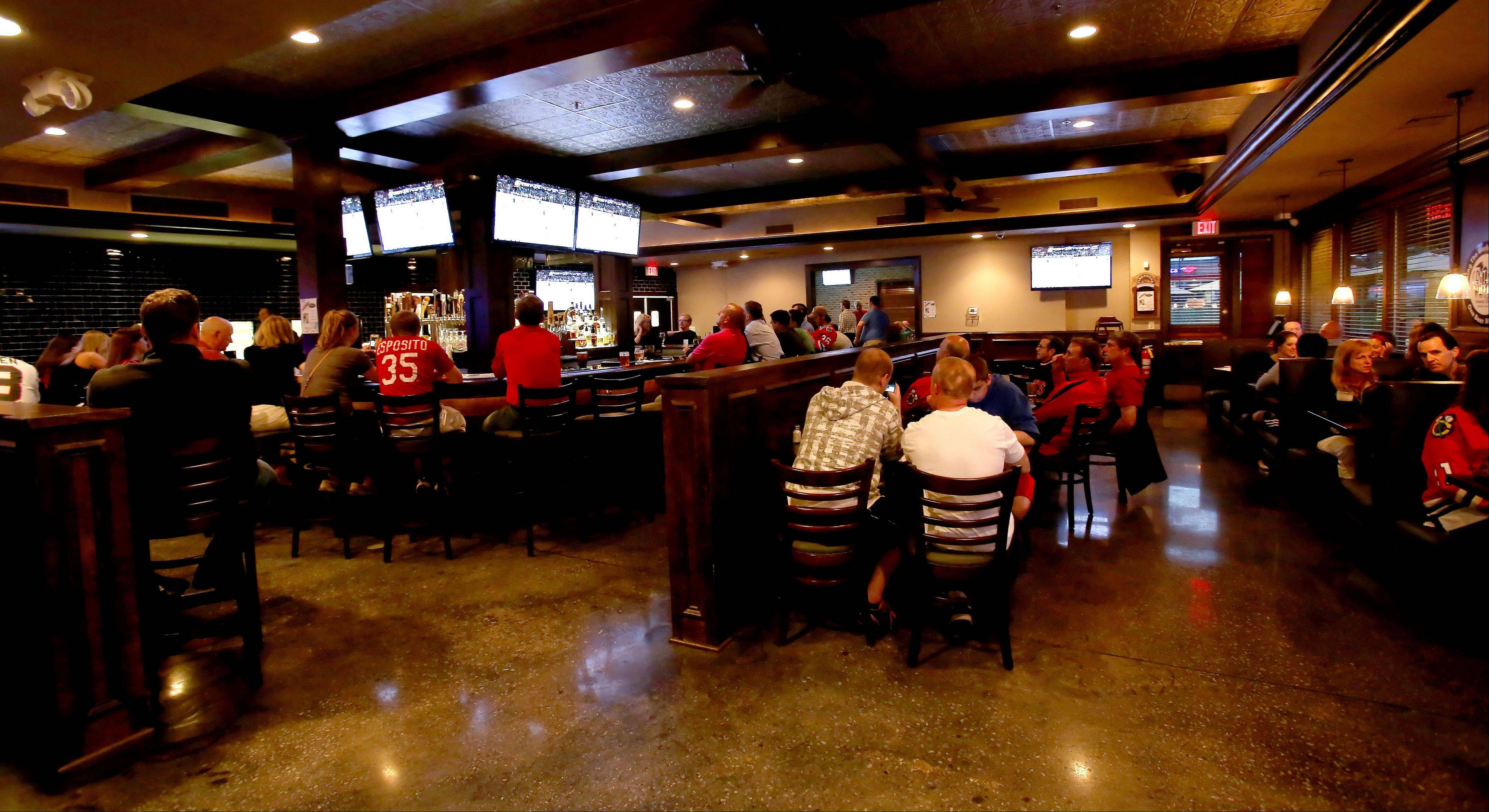 Sports fans should be happy with the many TVs in Warren's Ale House.