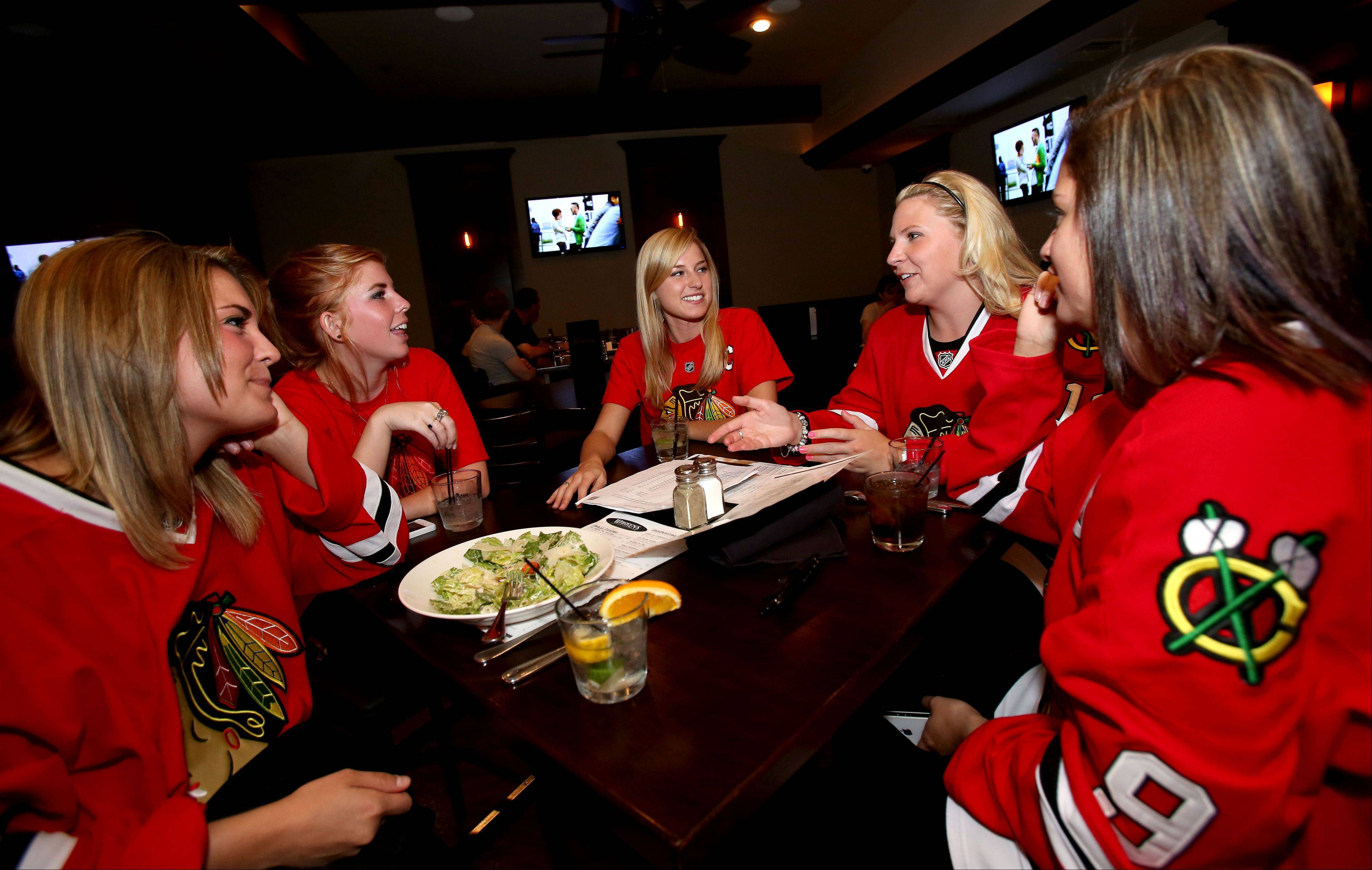 Fans Elise Bassi, left, Courtney Croft, Lindsey Hafer, Brittany Breisch and Macarena Hermosilla enjoyed a night out at Warren's Ale House in Wheaton during a recent Blackhawks game.