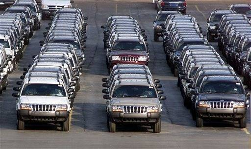 In this file photo trows of 2001 Jeep Grand Cherokees are lined up outside the Jefferson North Assembly Plant in Detroit. Chrysler is refusing a request by U.S. safety regulators to recall about 2.7 million vehicles to fix fuel tanks that could leak and cause fires in rear-end collisions.The company says it's been asked by the government to recall Jeep Grand Cherokees from 1993 through 2004 and Jeep Libertys from 2002 through 2007. But Chrysler says in a statement that the SUVs are safe and not defective.