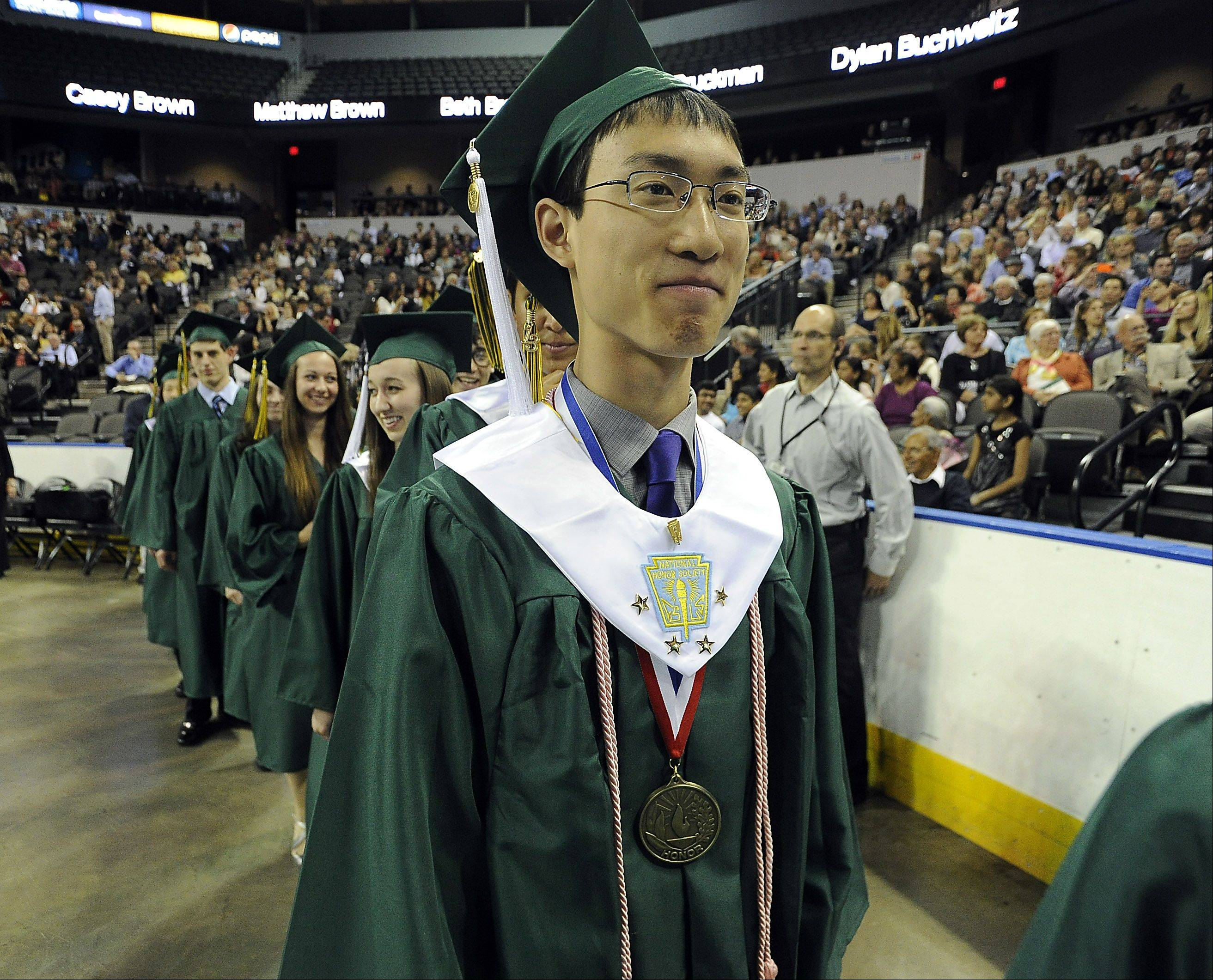 Justin Doong,18, of Kildeer walks in with classmates.
