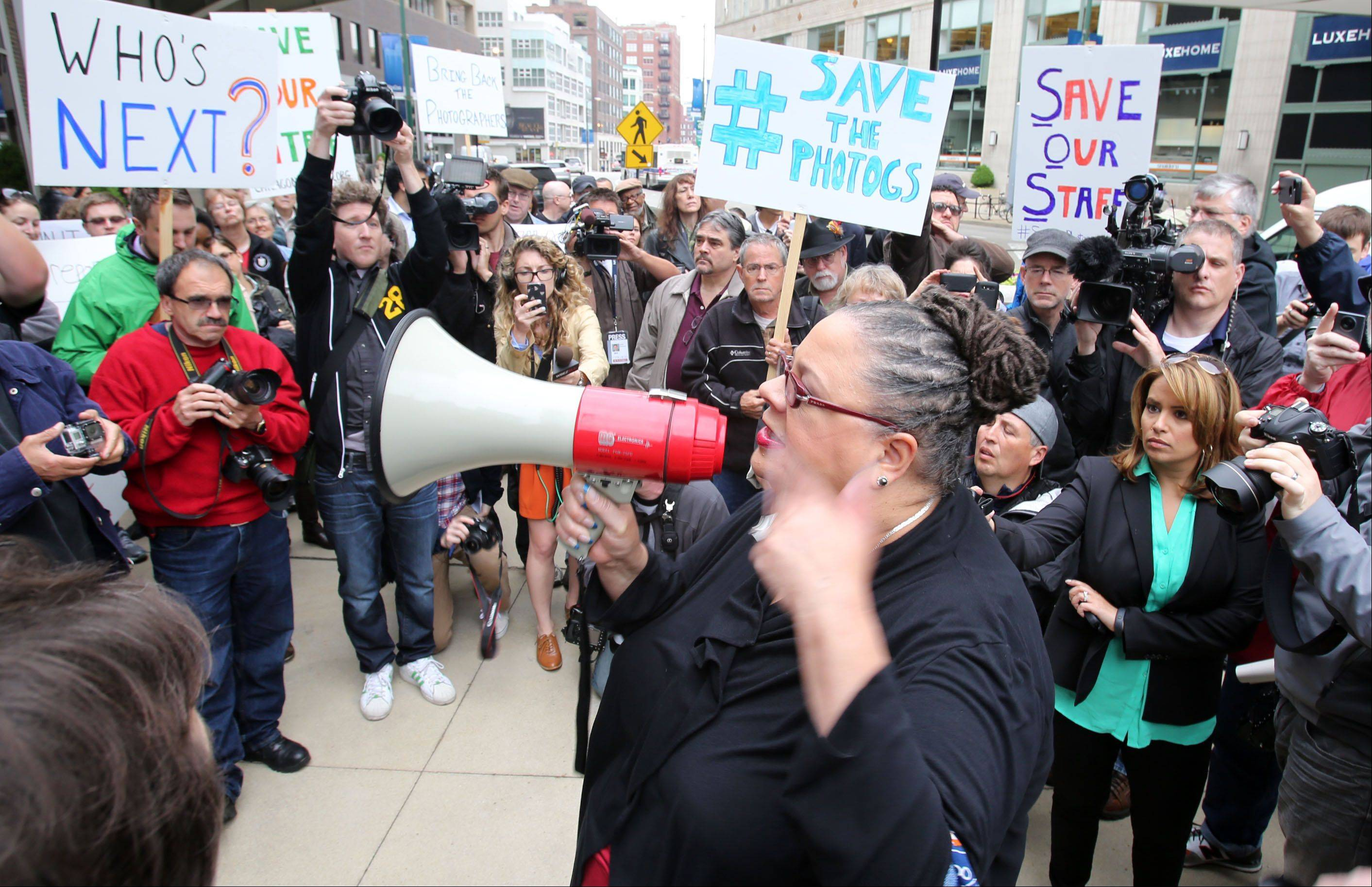 "Chicago Teachers Union President Karen Lewis speaks at a ""Save the Photographers"" rally Thursday in Chicago. The rally was organized by the Chicago Newspaper Guild to protest the Chicago Sun-Times' decision to lay off 28 photographers from its city and suburban newspapers."