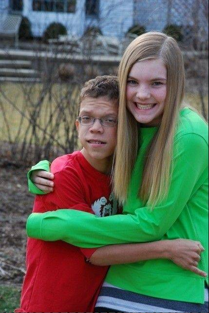 Chloe Kennebeck, 13, of Glen Ellyn is running a half marathon on behalf of her friend, Daniel Hess, and to raise money for research on inflammatory bowel diseases. Both have such a disease, though Daniel also suffers from autism and a rare genetic condition.