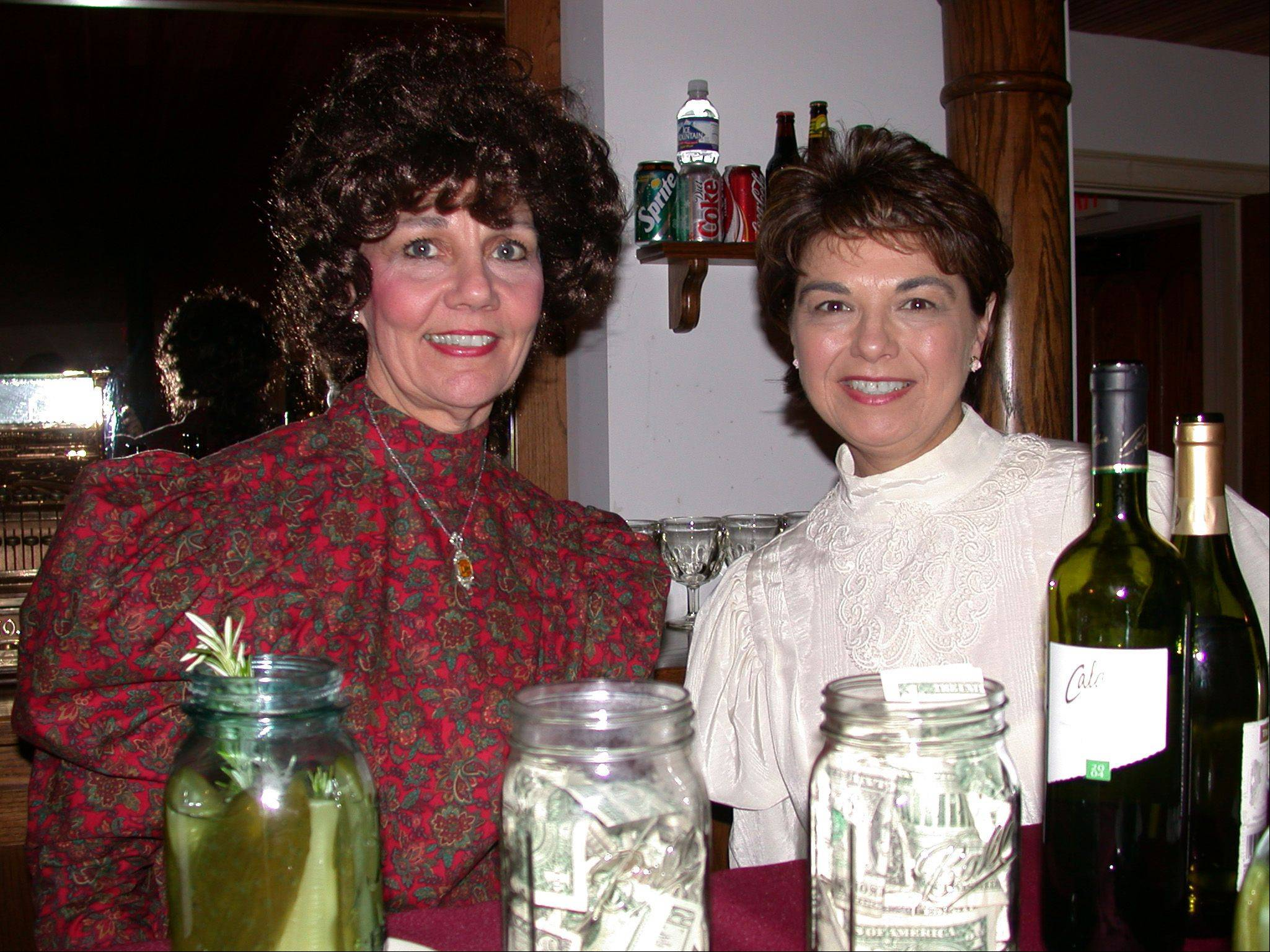 Stephanie Penick and Mary Ann Junkrowski as guest bartenders at Naper Settlement's $.35 club in the Pre-Emption House Tavern.
