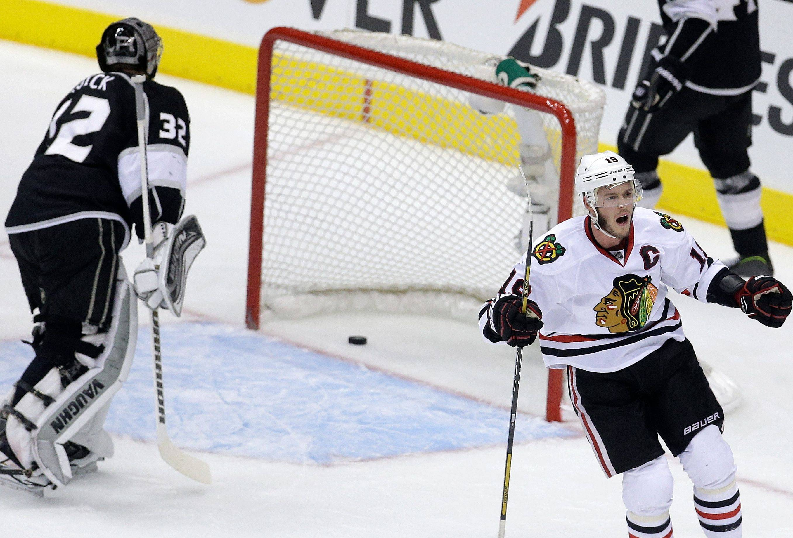 Jonathan Toews celebates Bryan Bickell's first-period goal past Kings goalie Jonathan Quick during Game 4 of the Western Conference finals Thursday.