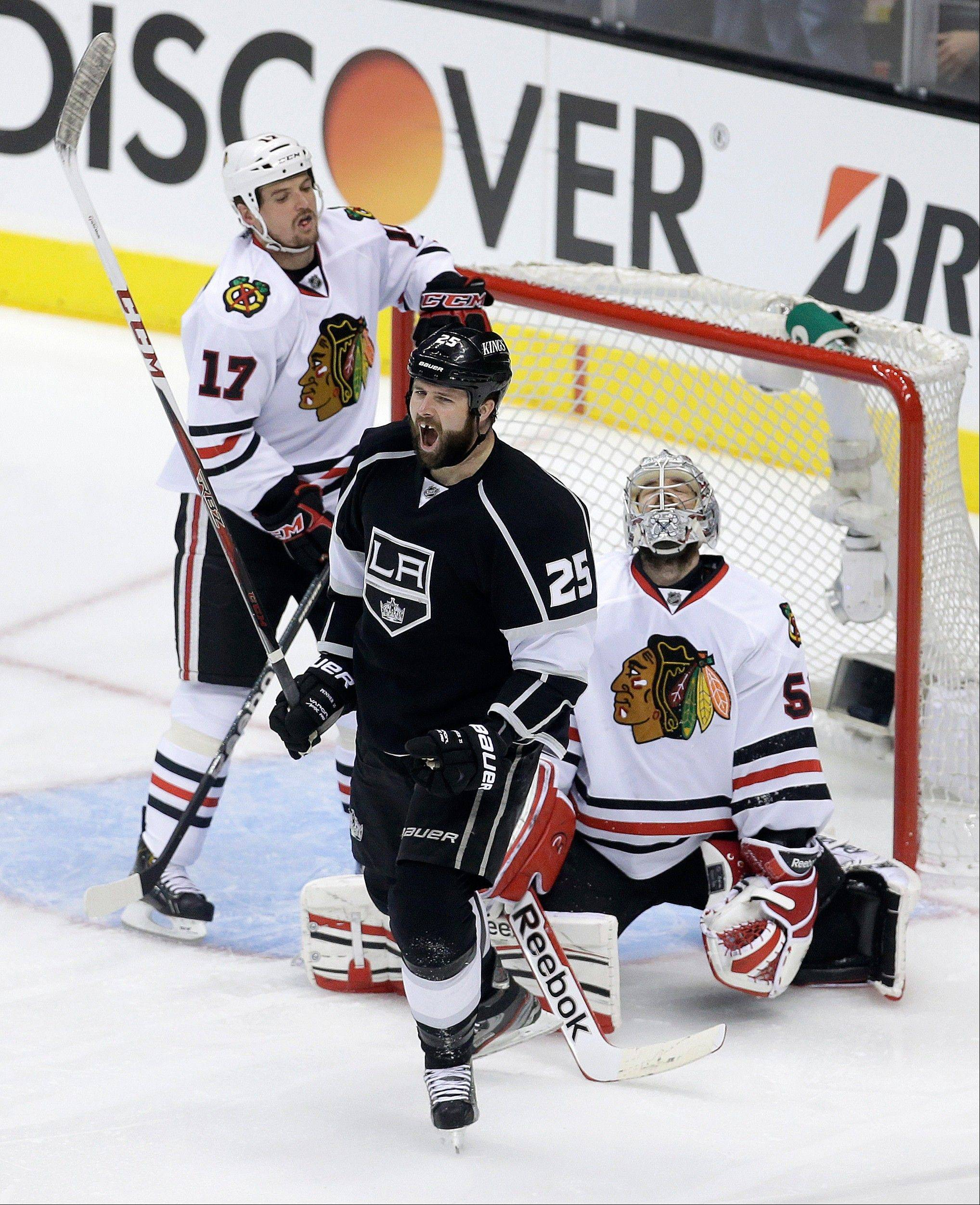 Los Angeles Kings left wing Dustin Penner, middle, celebrates his goal, in front ofChicago Blackhawks goalie Corey Crawford, right, and Sheldon Brookbank during the second period of Game 4 of the Western Conference finals in Los Angeles on Thursday.