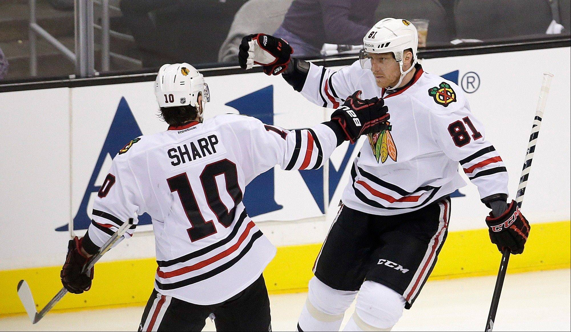Chicago Blackhawks right wing Marian Hossa, right, celebrates his goal with Patrick Sharp during the third period against the Los Angeles Kings in Game 4 of the NHL hockey Stanley Cup playoffs Western Conference finals, in Los Angeles on Thursday, June 6, 2013.