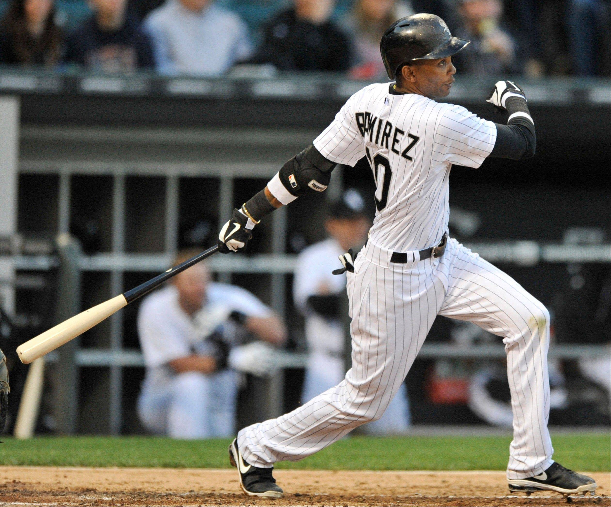 Chicago White Sox's Alexei Ramirez watches his two-run single during the third inning of a baseball game against the Oakland Athletics in Chicago, Thursday, June 6, 2013.