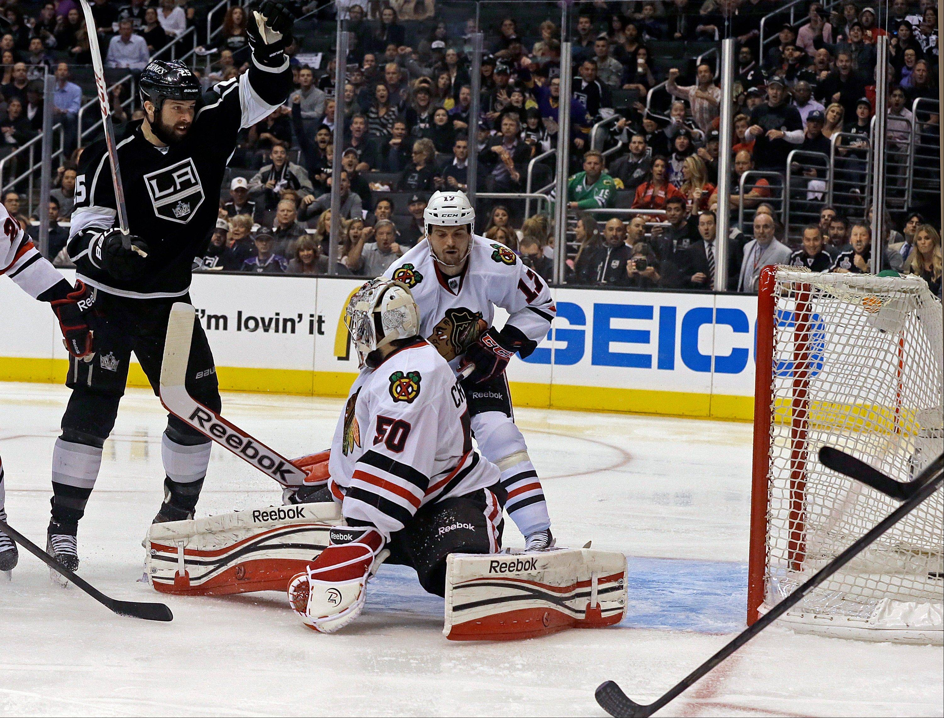 Los Angeles Kings left winger Dustin Penner, left, celebrates his goal against Chicago Blackhawks goalie Corey Crawford (50) in the second period of Game 4 of the NHL hockey Stanley Cup playoffs Western Conference finals, in Los Angeles on Thursday, June 6, 2013.