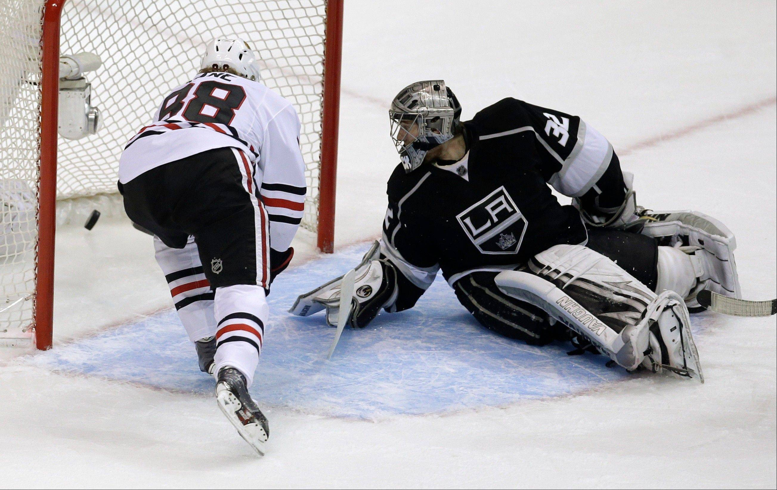 Chicago Blackhawks right wing Patrick Kane scores past Los Angeles Kings goalie Jonathan Quick during the second period in Game 4 of the NHL hockey Stanley Cup playoffs Western Conference finals, in Los Angeles, Thursday, June 6, 2013.